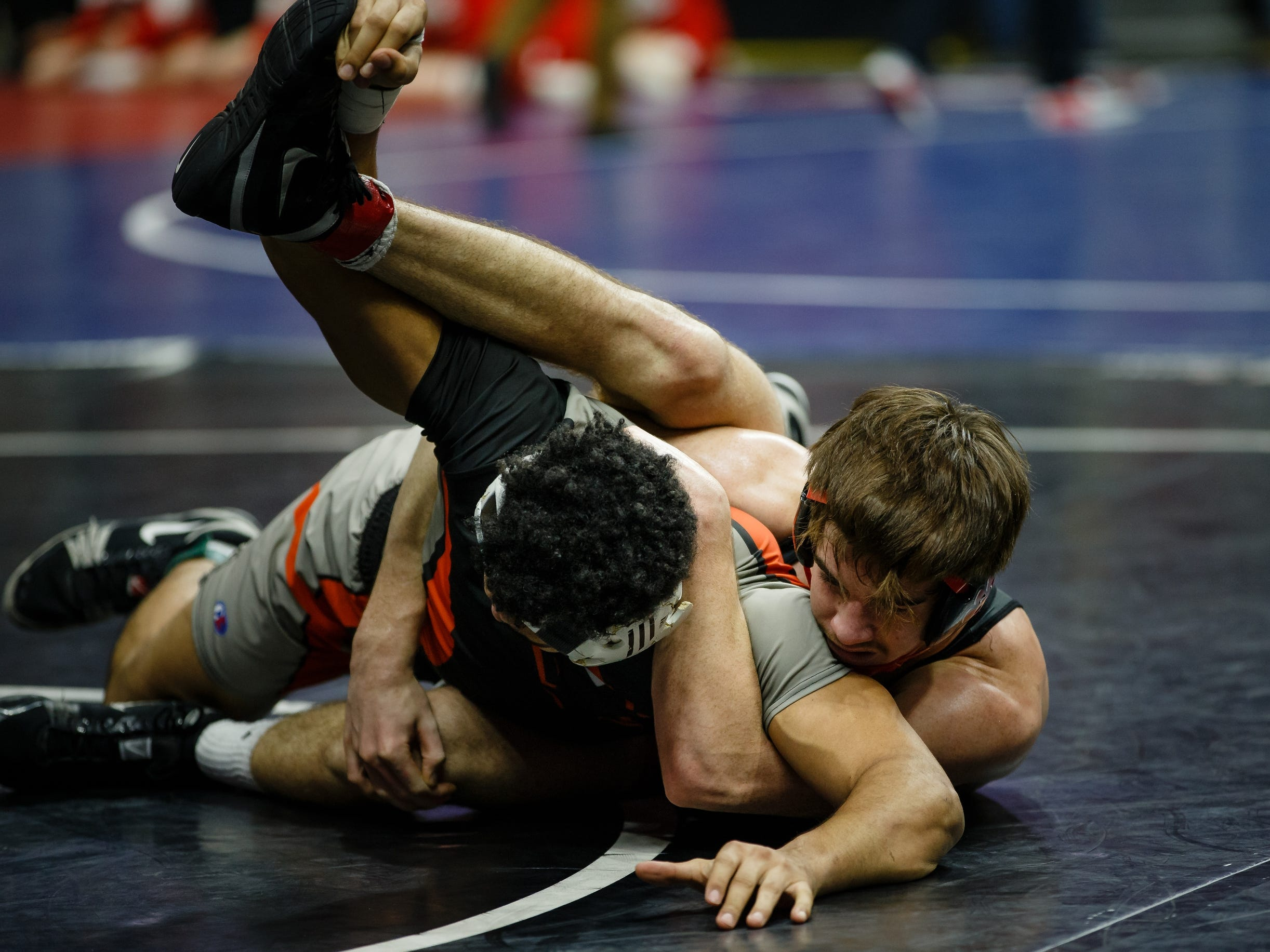 Nolan Harsh of ADM wrestles Tristin Westphal of Washington during their class 2A 182 pound state championship semi-final match on Friday, Feb. 15, 2019 in Des Moines. Tristin Westphal moves onto the finals.
