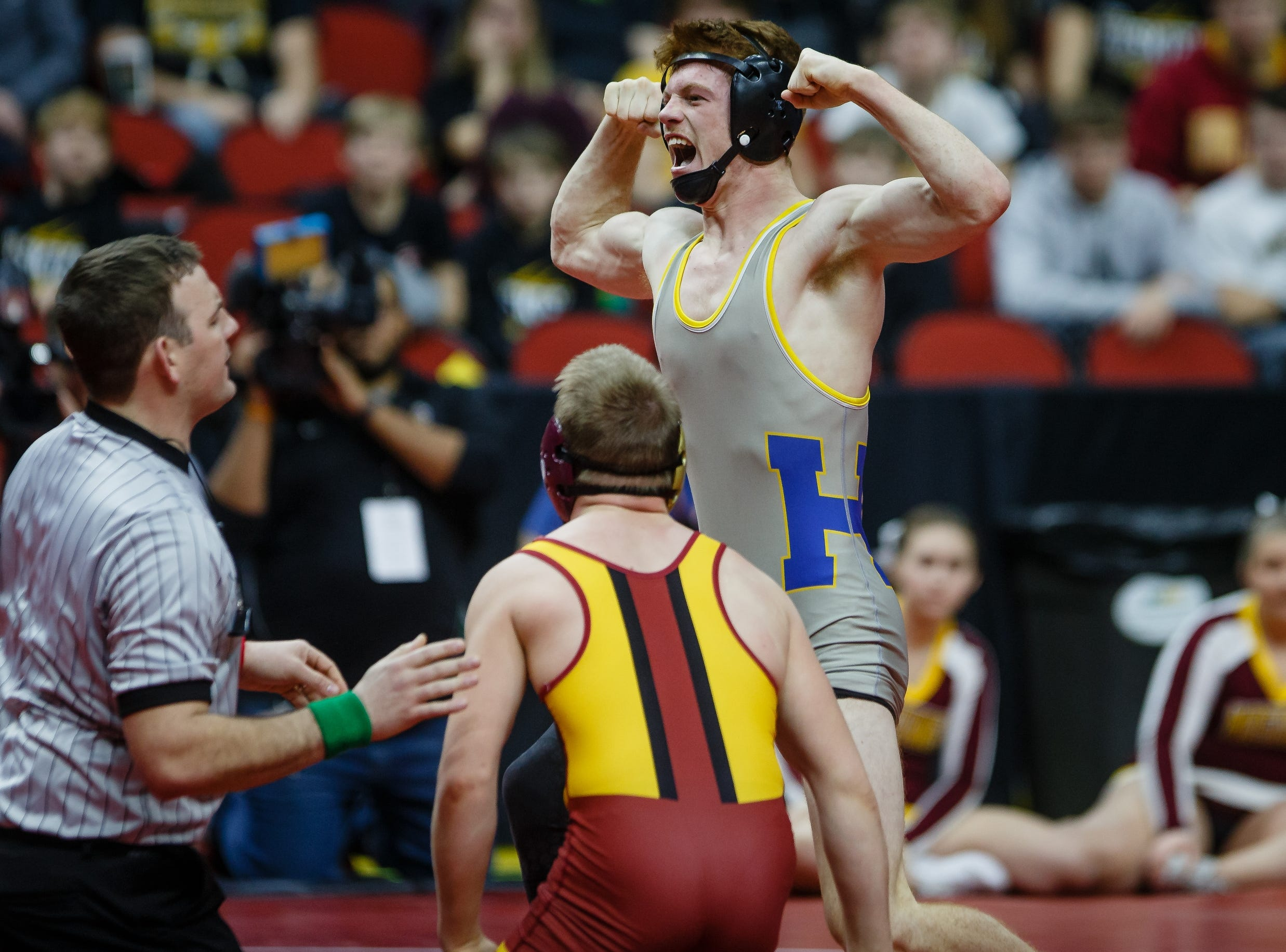 Joey Busse of Humbolt reacts after defeating Colby Tool of PCM during their class 2A, 145-pound state championship semifinal match on Friday  in Des Moines.