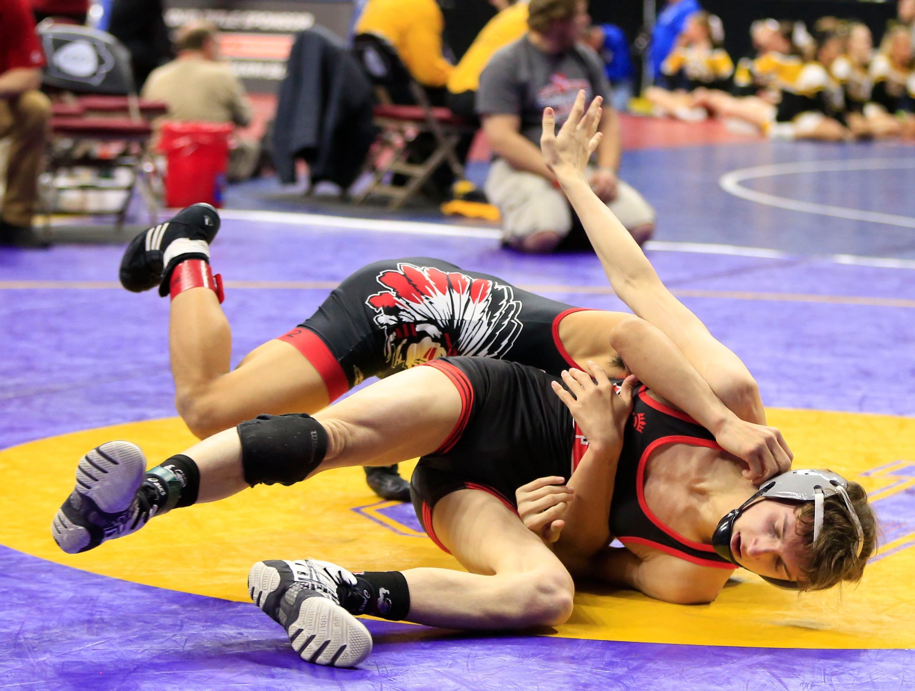 Nathaniel Genobana of Centerville defeats Jason Peta of Estherville-Lincoln Central during a 120 Lb 2A quarterfinal match at the state wrestling tournament Friday, Feb. 15, 2019.