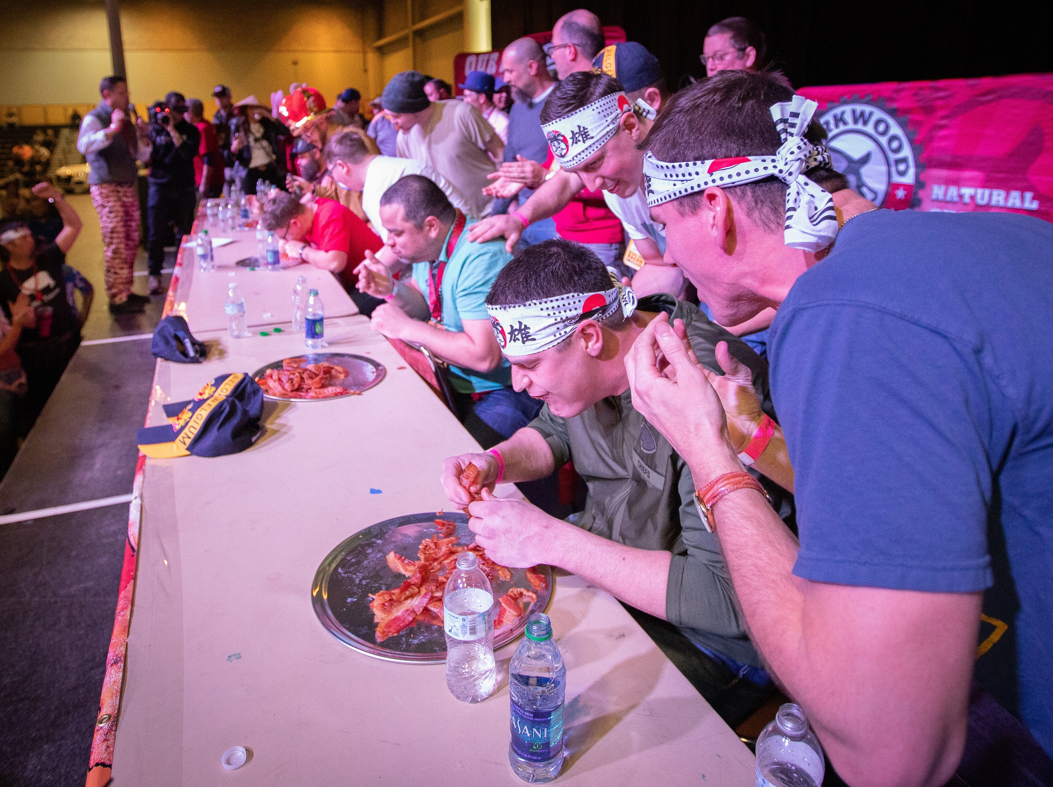 Patrons participate in the eating contest during the Bacon Fest at Hy-Vee Hall on Feb. 16, 2019 in Des Moines, Iowa.