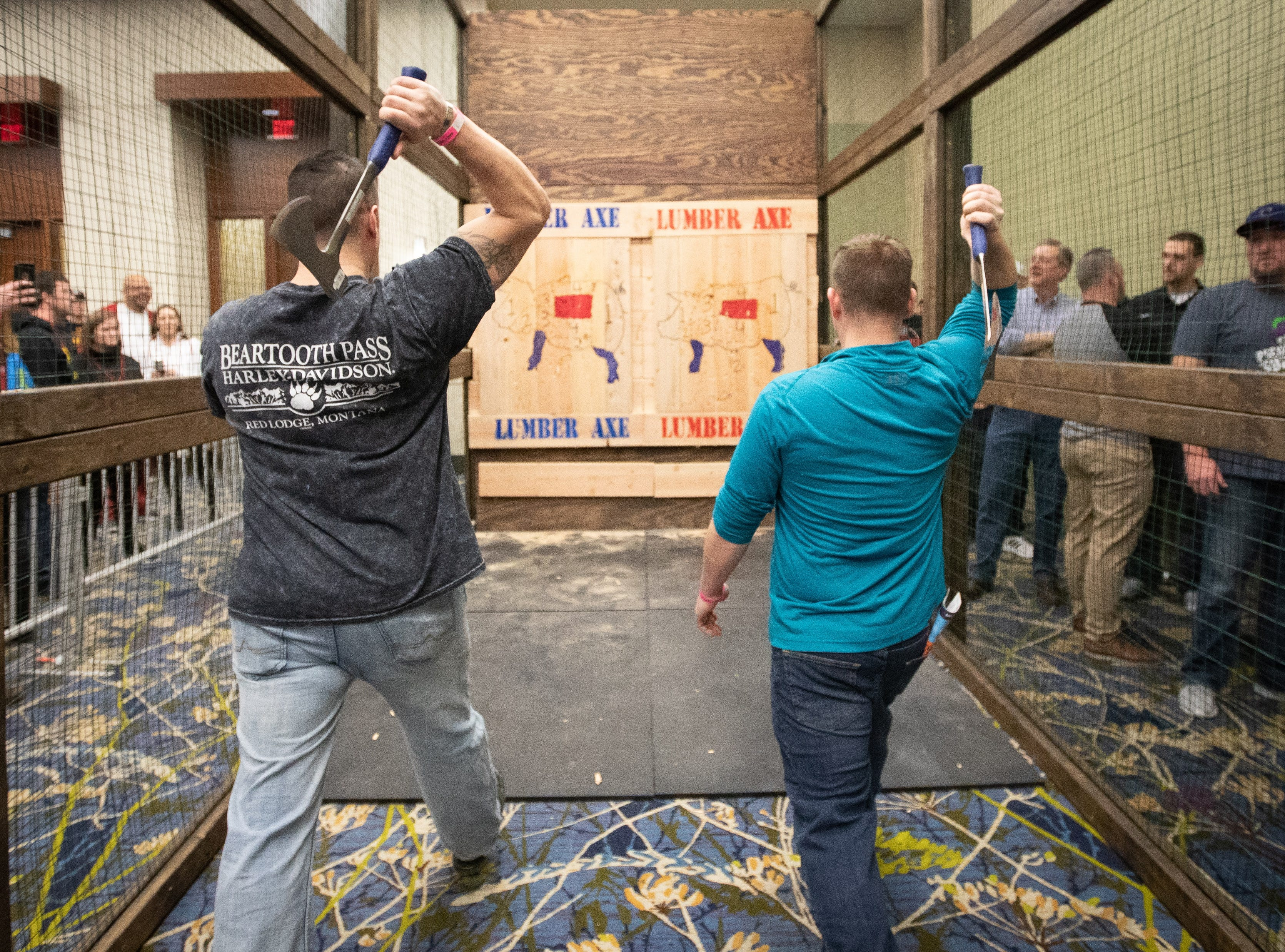 Shawn Parks and Jason Stoos, of Des Moines, throw axe during the Bacon Fest at Hy-Vee Hall on Feb. 16, 2019 in Des Moines, Iowa.
