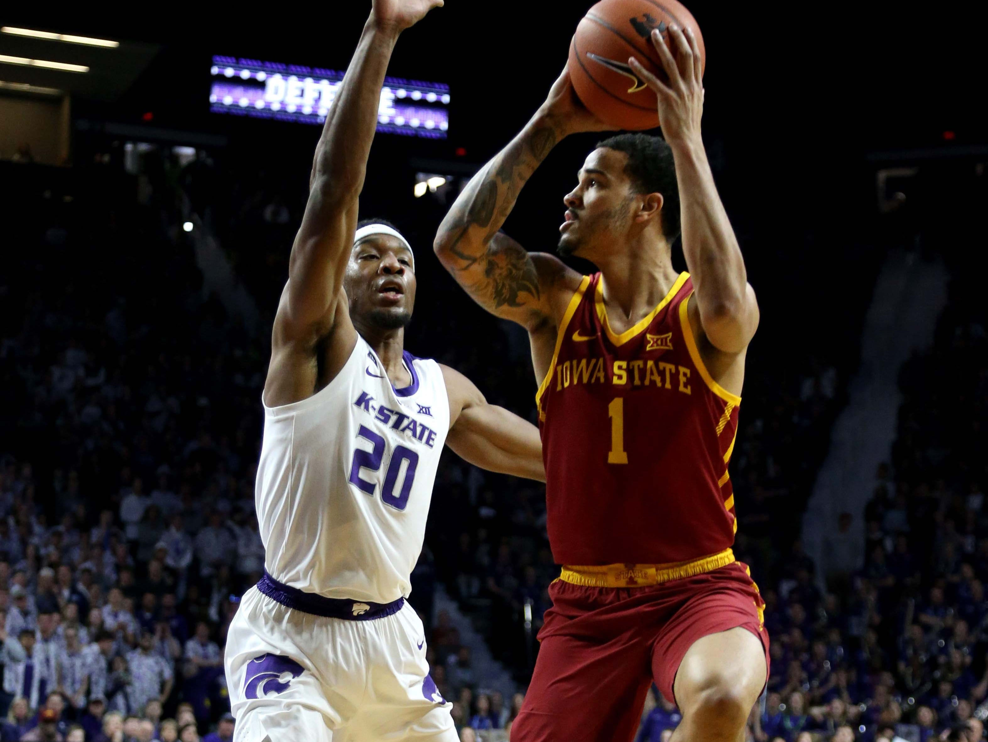 Feb 16, 2019; Manhattan, KS, USA; Iowa State Cyclones guard Nick Weiler-Babb (1) is guarded by Kansas State Wildcats forward Xavier Sneed (20) during the first half at Bramlage Coliseum.
