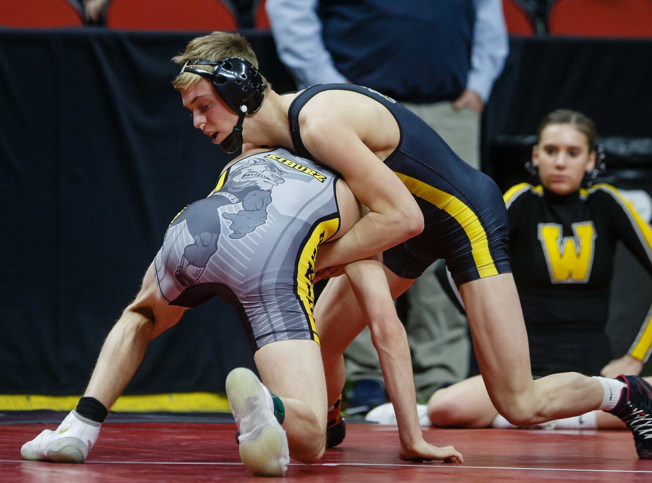 Eric Faught of Clear Lake wrestles Kruise Kiburz of Winterset during their class 2A 132 pound state championship semi-final match on Friday, Feb. 15, 2019 in Des Moines. Faught moves onto the finals with a 7-1 decision.
