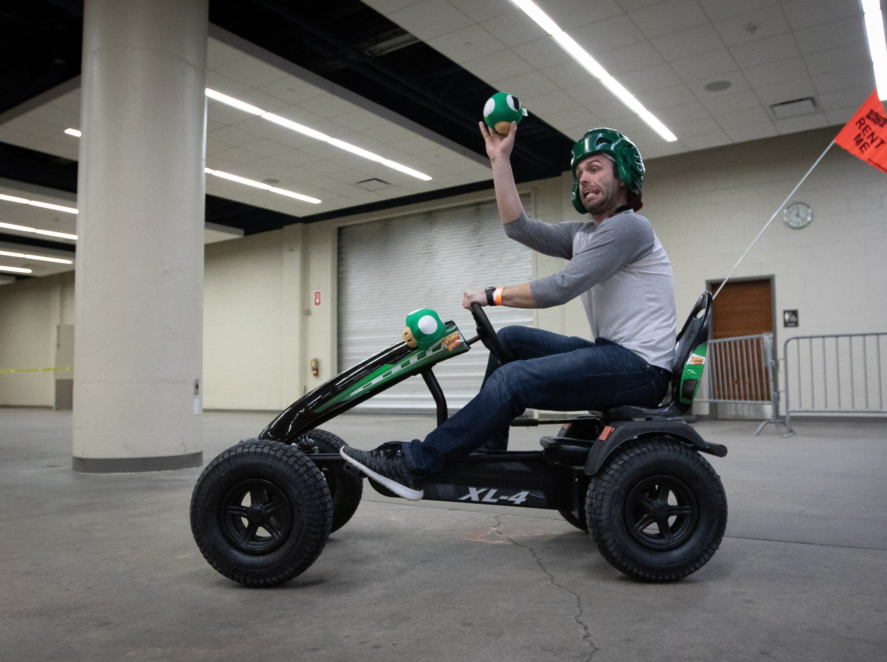 Jose Ruth, of Clive, participates in a go-kart race during the Bacon Fest at Hy-Vee Hall on Feb. 16, 2019 in Des Moines, Iowa.