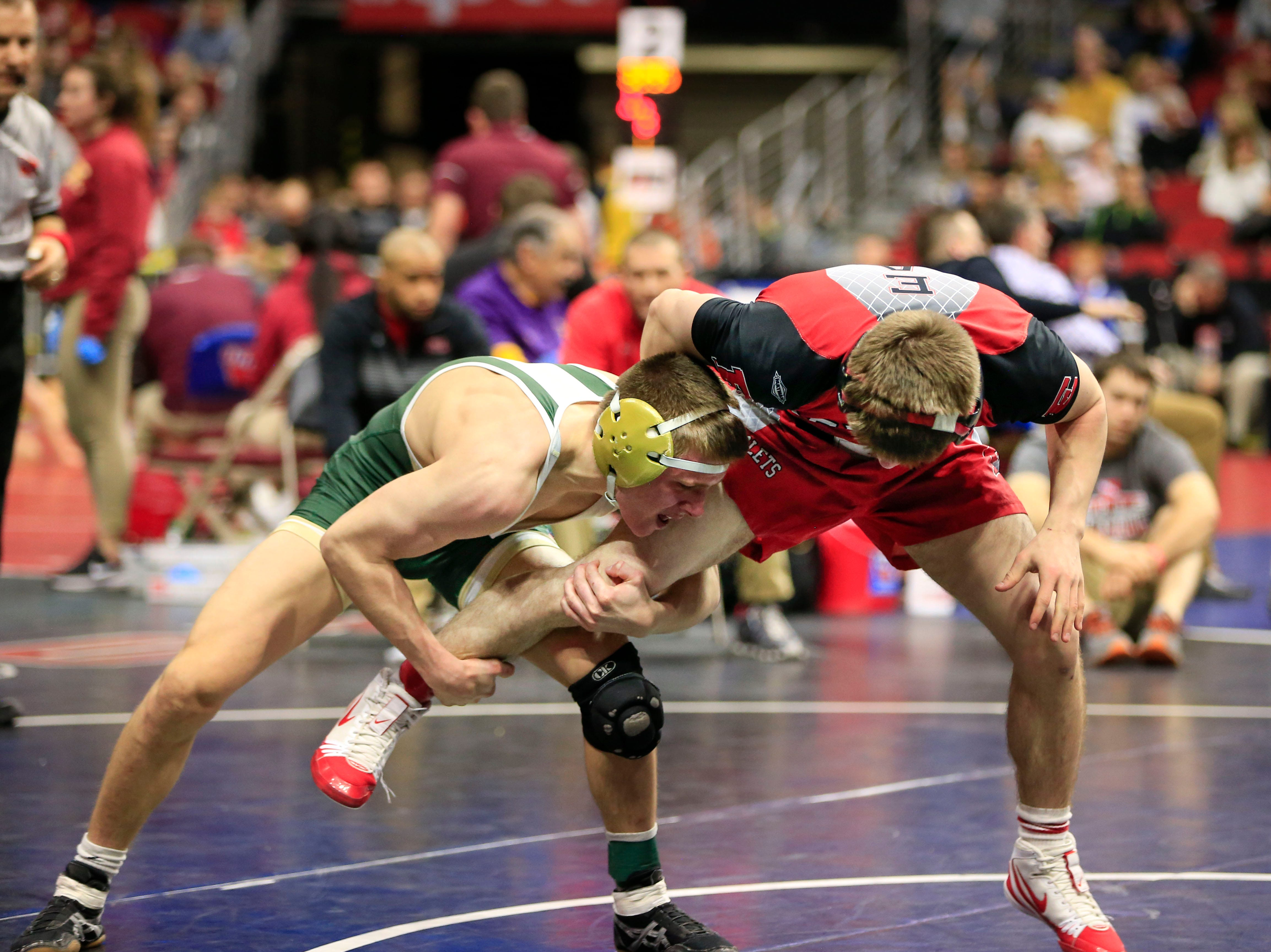 Joe Pins of Dubuque Hempstead defeats Brock Espalin of Des Moines East during a 132 Lb 3A semifinal match at the state wrestling tournament Friday, Feb. 15, 2019.