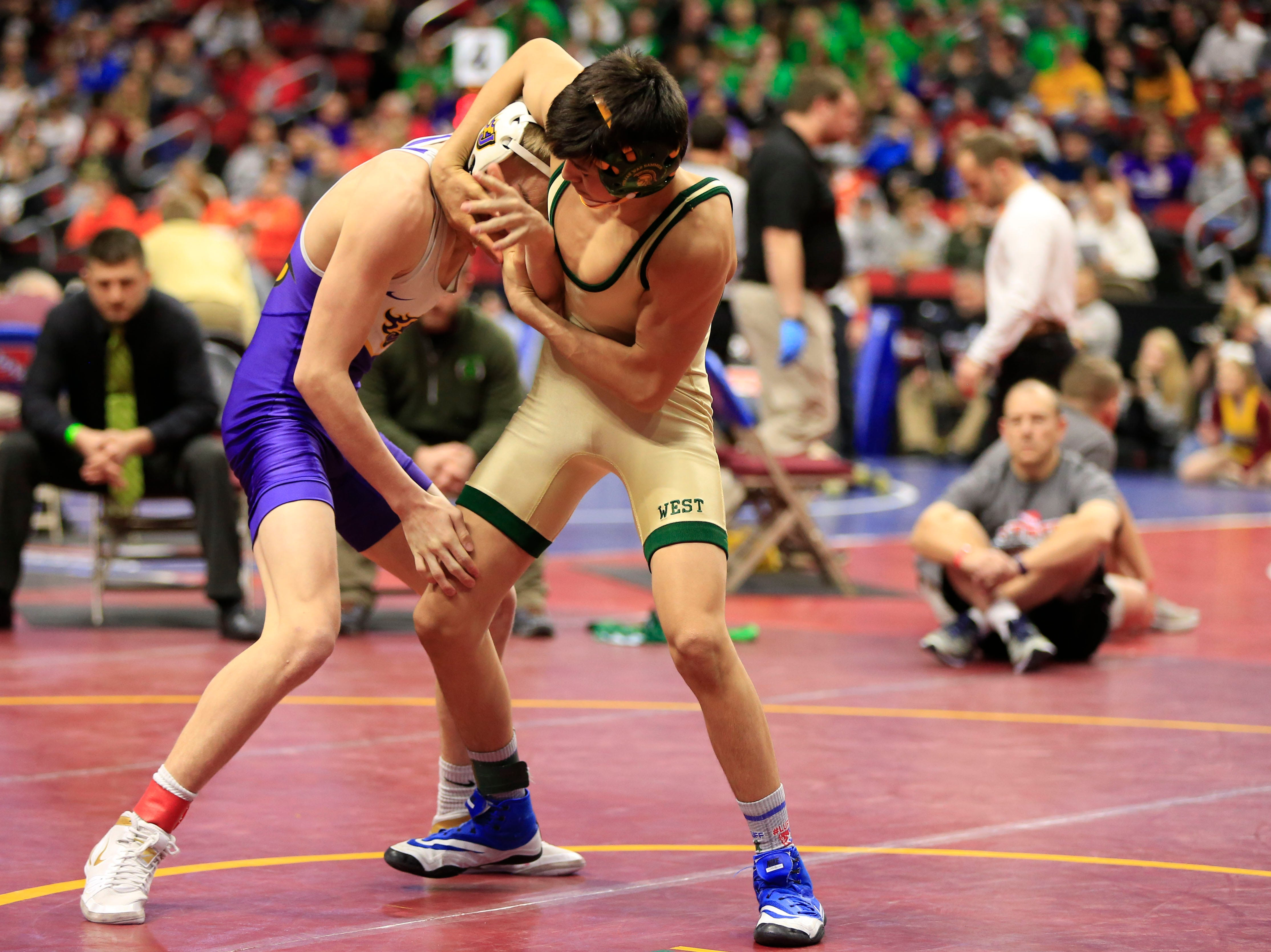 Hunter Garvin of Iowa City, West defeats Thomas Edwards of Johnston during a 120 Lb 3A semifinal match at the state wrestling tournament Friday, Feb. 15, 2019.