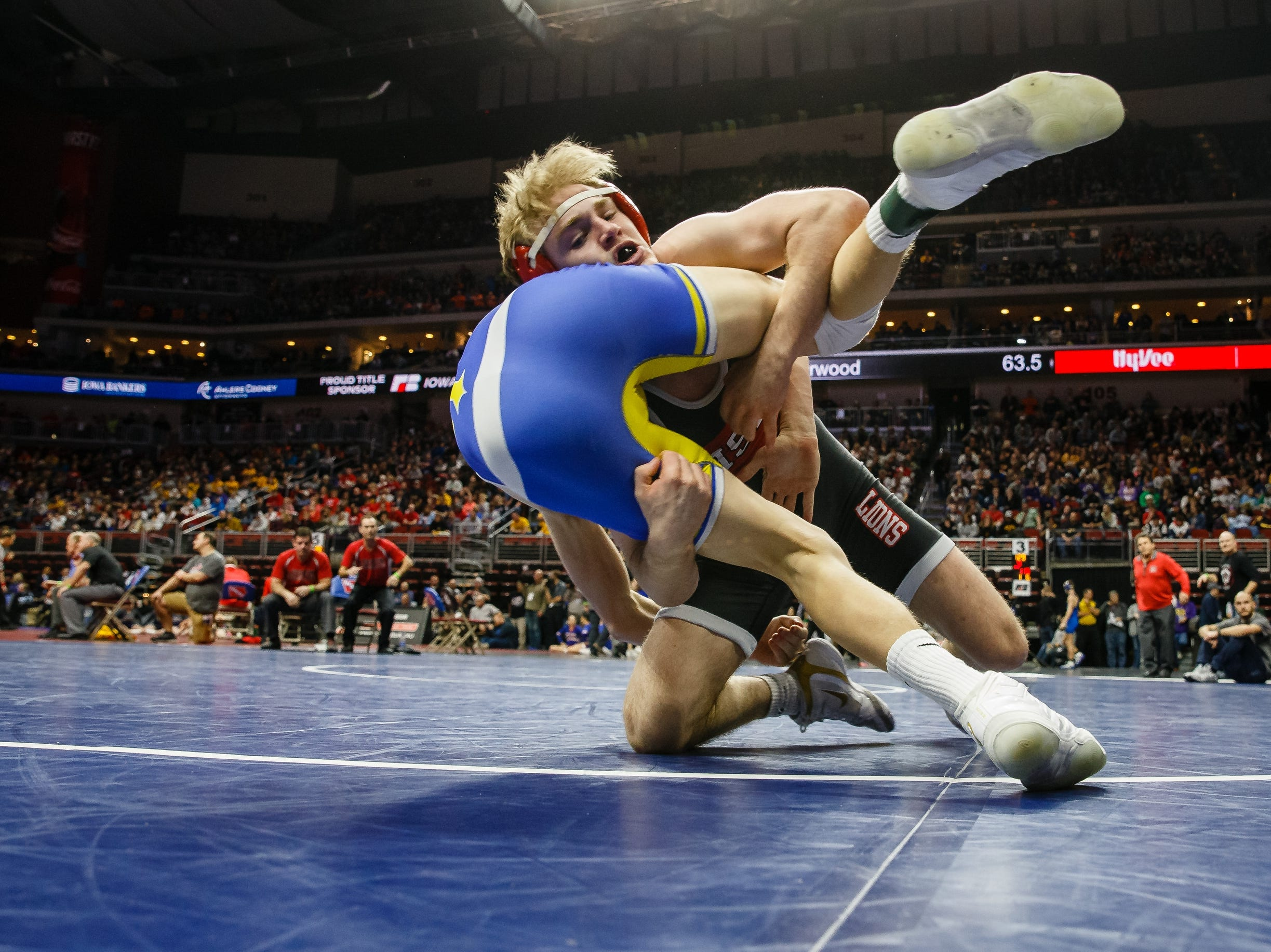 Cael Happel of Lisbon wrestles Easton Larson of Don Bosco during their class 1A, 132-pound state championship semifinal match on Friday in Des Moines. Happel moves onto the final with a 24-9 tech fall.