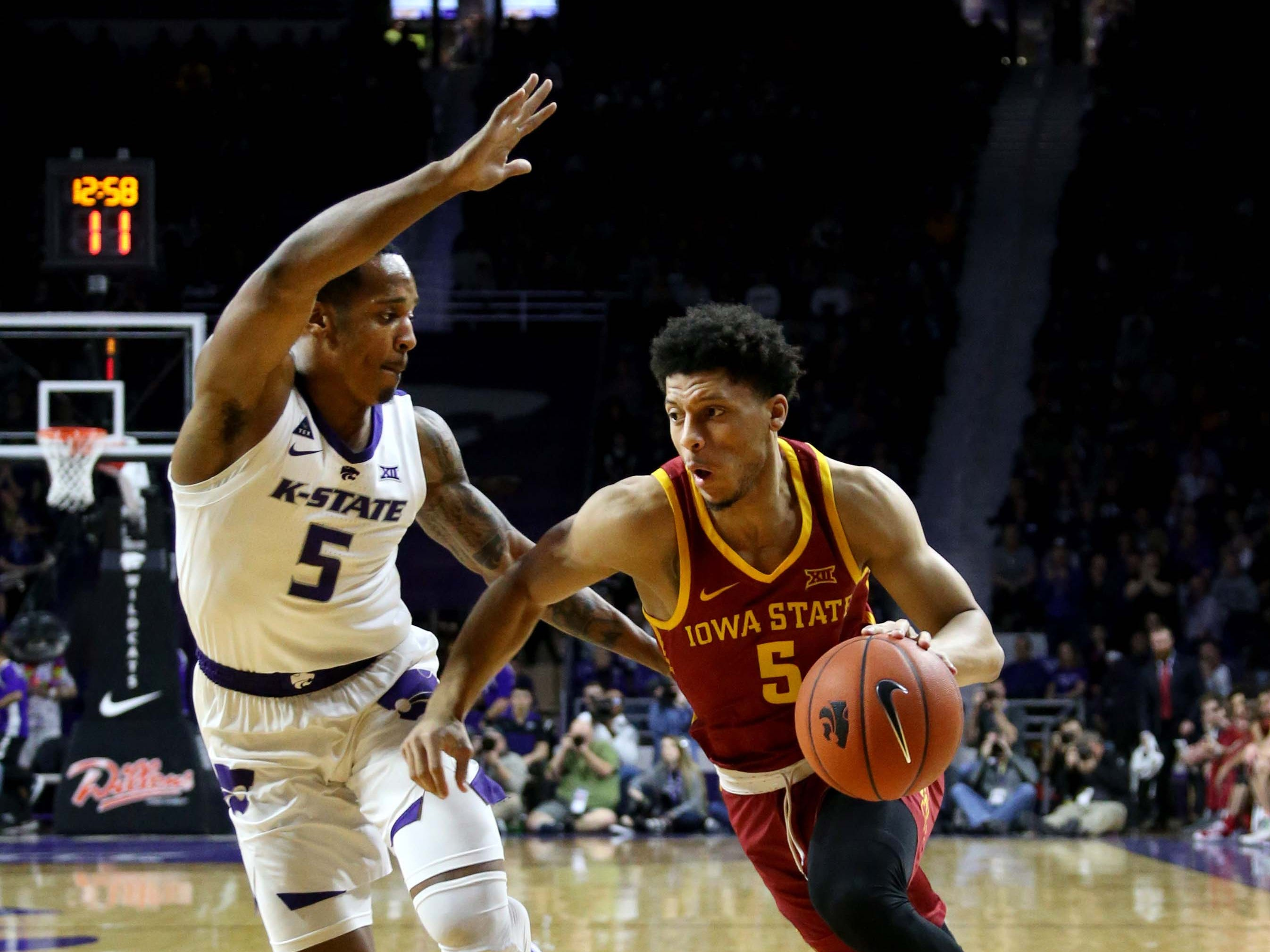 Feb 16, 2019; Manhattan, KS, USA; Iowa State Cyclones guard Lindell Wigginton (5) dribbles by Kansas State Wildcats guard Barry Brown (5) during the first half at Bramlage Coliseum.