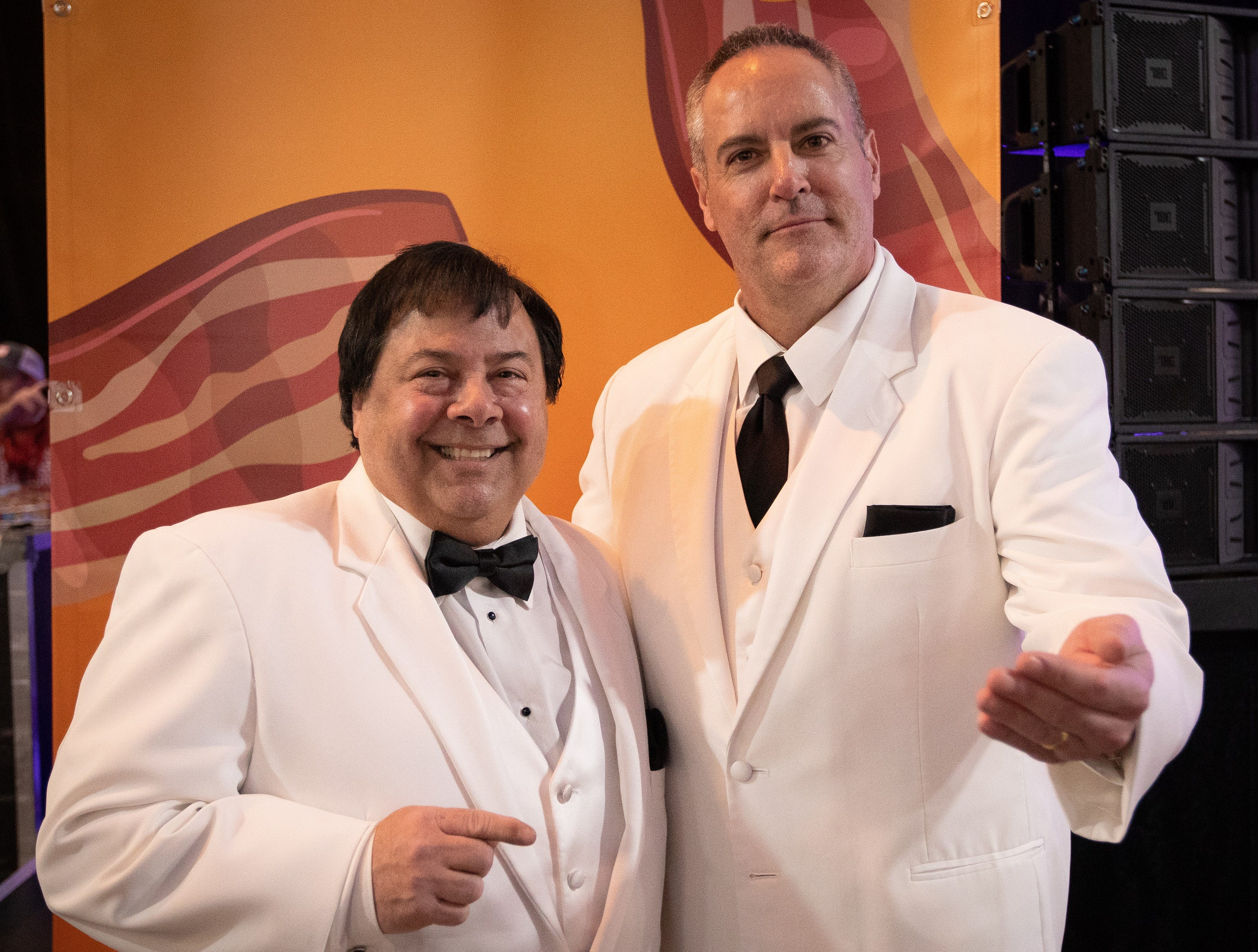 Paul Schulte, of Urbandale, and Davit Hott, of Des Moines, pose for a photo after winning the costume contest as characters from the tv show Fantasy Island during the Bacon Fest at Hy-Vee Hall on Feb. 16, 2019 in Des Moines, Iowa.