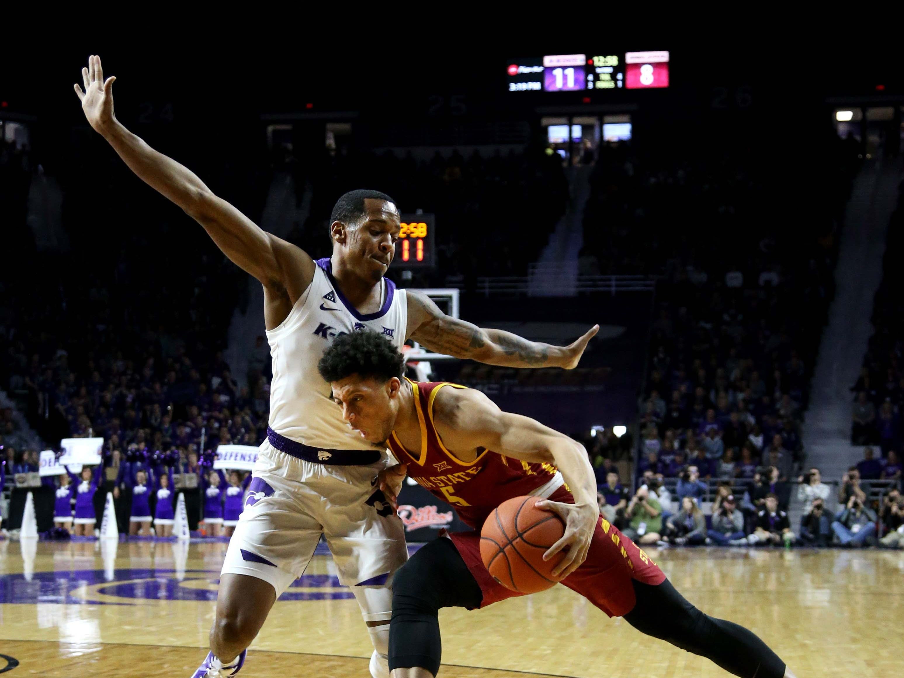 Feb 16, 2019; Manhattan, KS, USA; Iowa State Cyclones guard Lindell Wigginton (5) is guarded by Kansas State Wildcats guard Barry Brown (5) during the first half at Bramlage Coliseum.