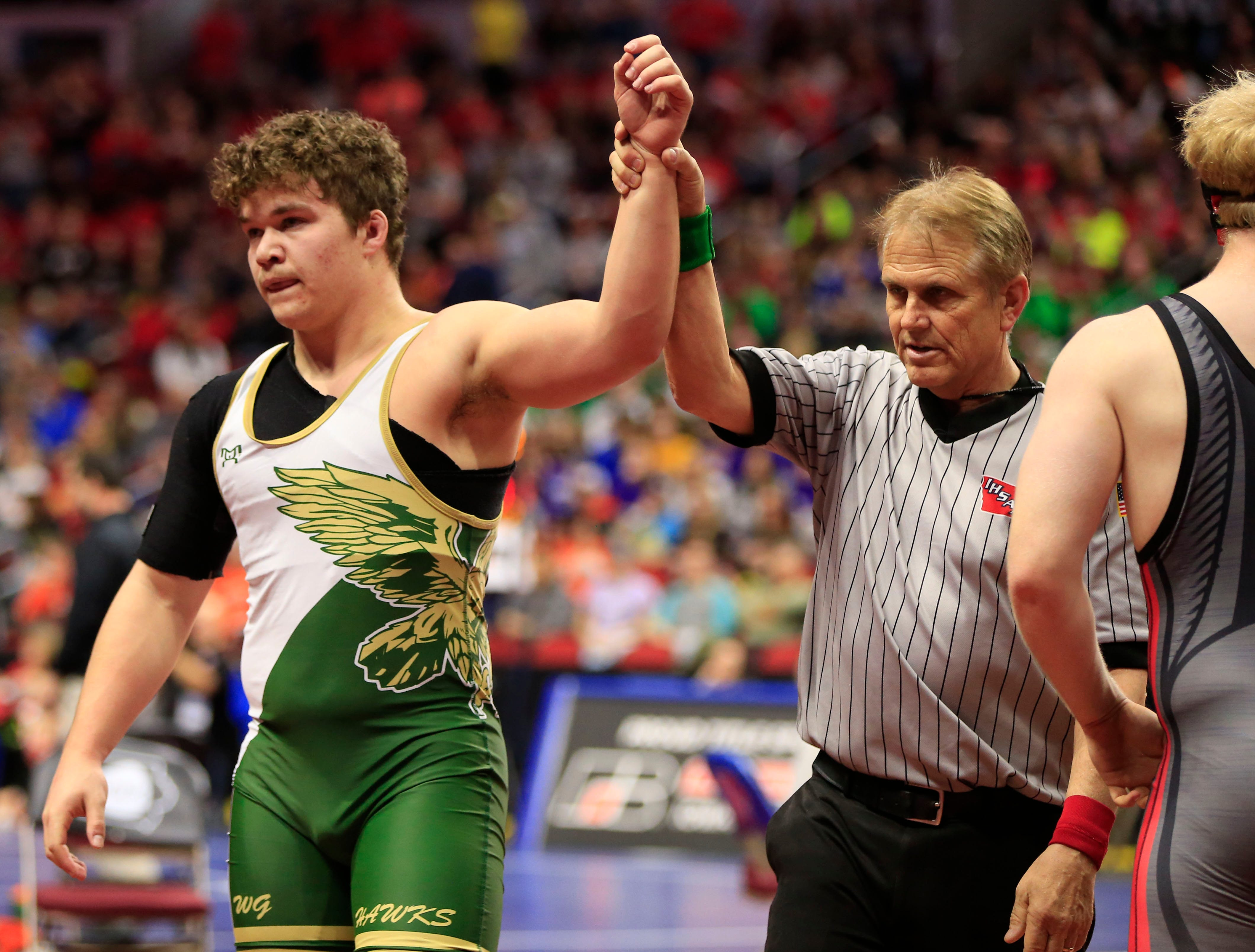 Cody Fisher of Woodward Granger defeats Wyatt Folkerts of Hampton-Dumontduring a 220 Lb 2A quarterfinal match at the state wrestling tournament Friday, Feb. 15, 2019.