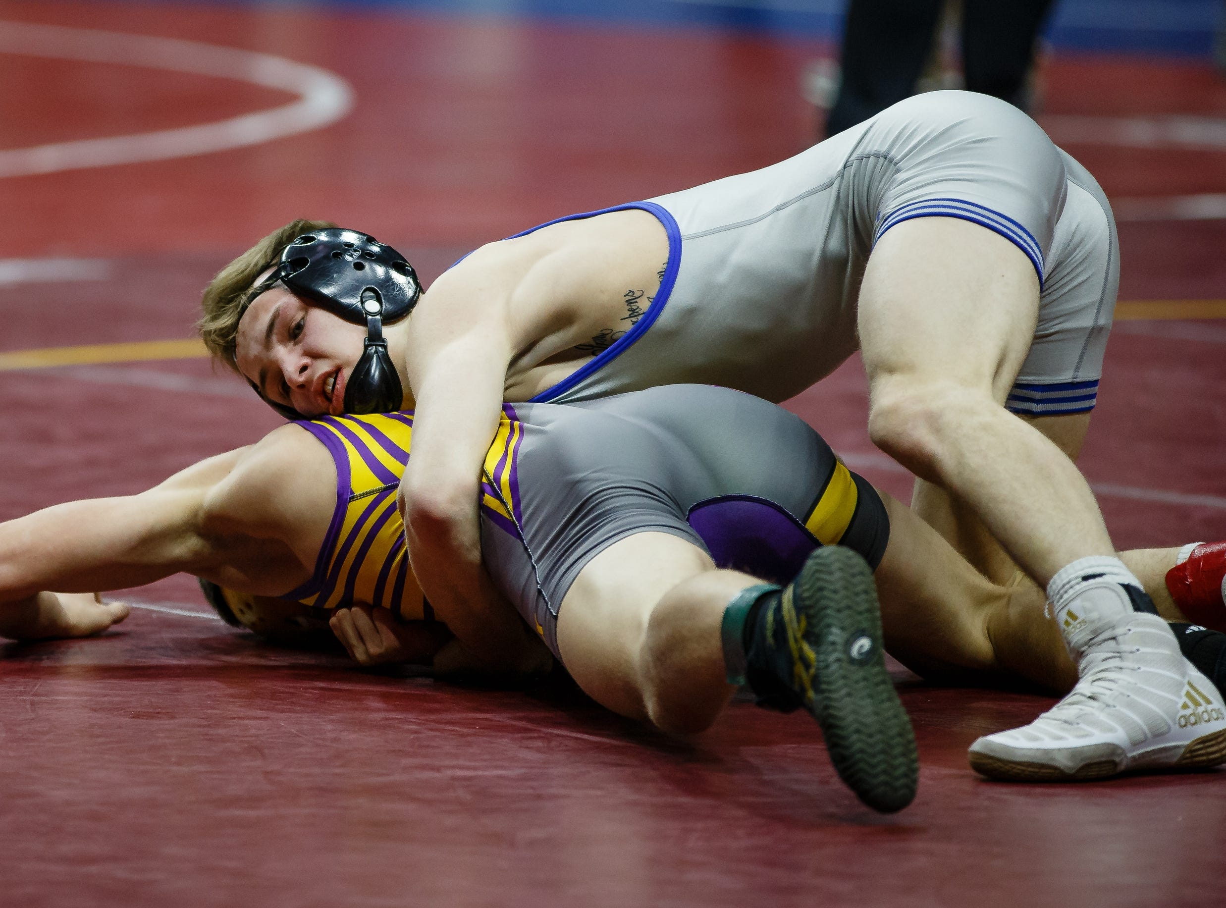 Kaden Anderlik of Crestwood, Cresco wrestles Drake Doolittle of Webster City during their class 2A 120 pound state championship semi-final match on Friday, Feb. 15, 2019 in Des Moines. Doolittle moves onto the finals with an 8-3 decision.
