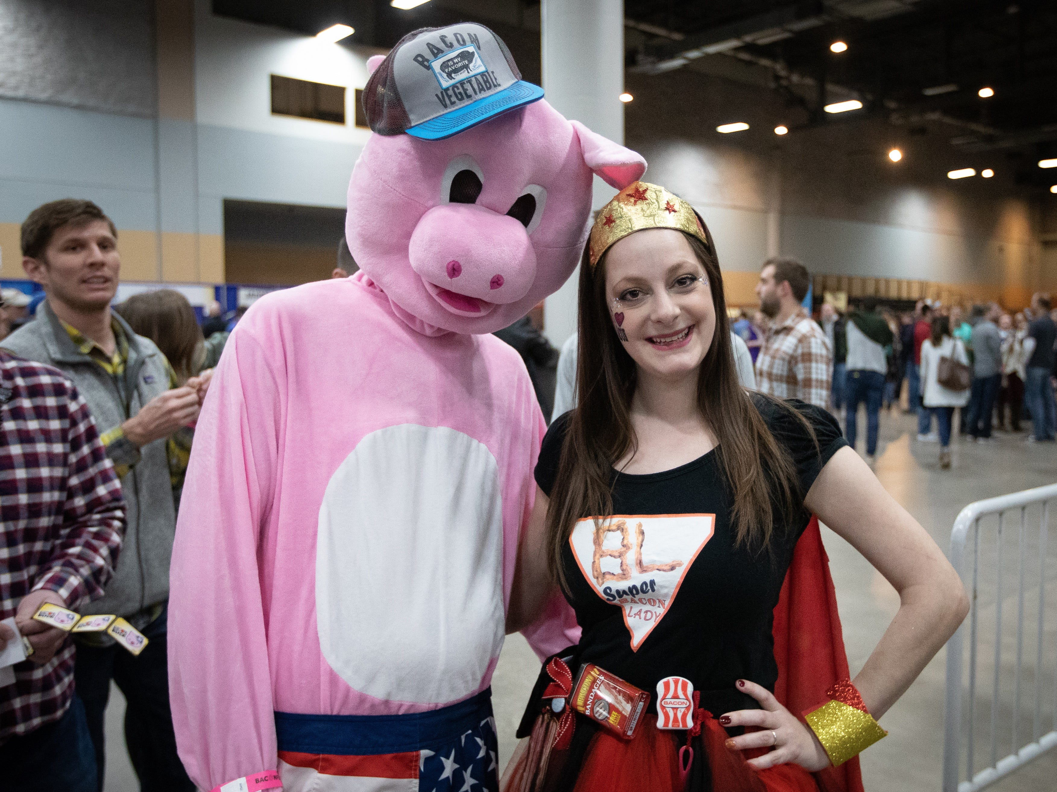 Super Bacon Lady and Side of Bacon pose for a photo during the Bacon Fest at Hy-Vee Hall on Feb. 16, 2019 in Des Moines, Iowa.