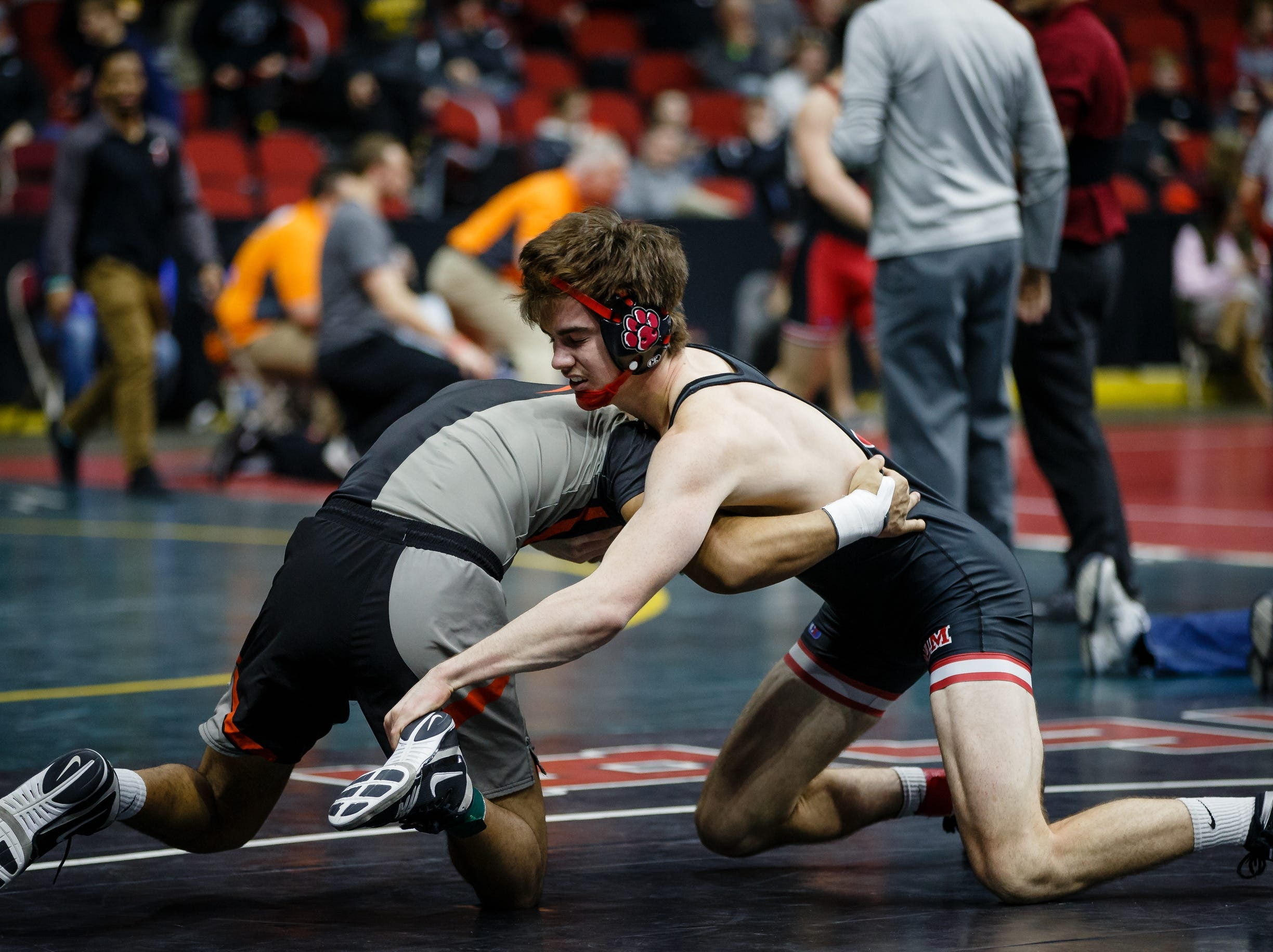 Nolan Harsh of ADM wrestles Tristin Westphal of Washington during their class 2A 182 pound state championship semi-final match on Friday, Feb. 15, 2019 in Des Moines. Westphal advances to the finals.