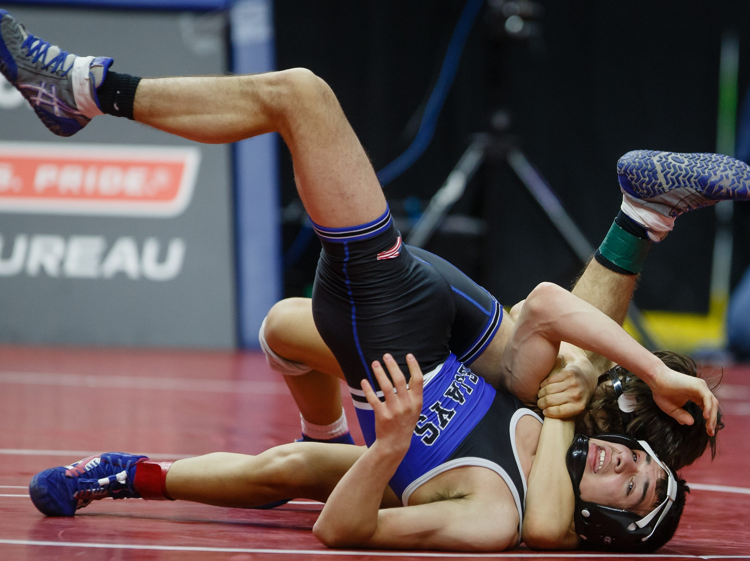Isaiah Weber of Independence wrestles Colby Lillegard of Bondurant-Farrar during their class 2A 113 pound state championship semi-final match on Friday, Feb. 15, 2019 in Des Moines. Weber moves onto the finals with a fall.