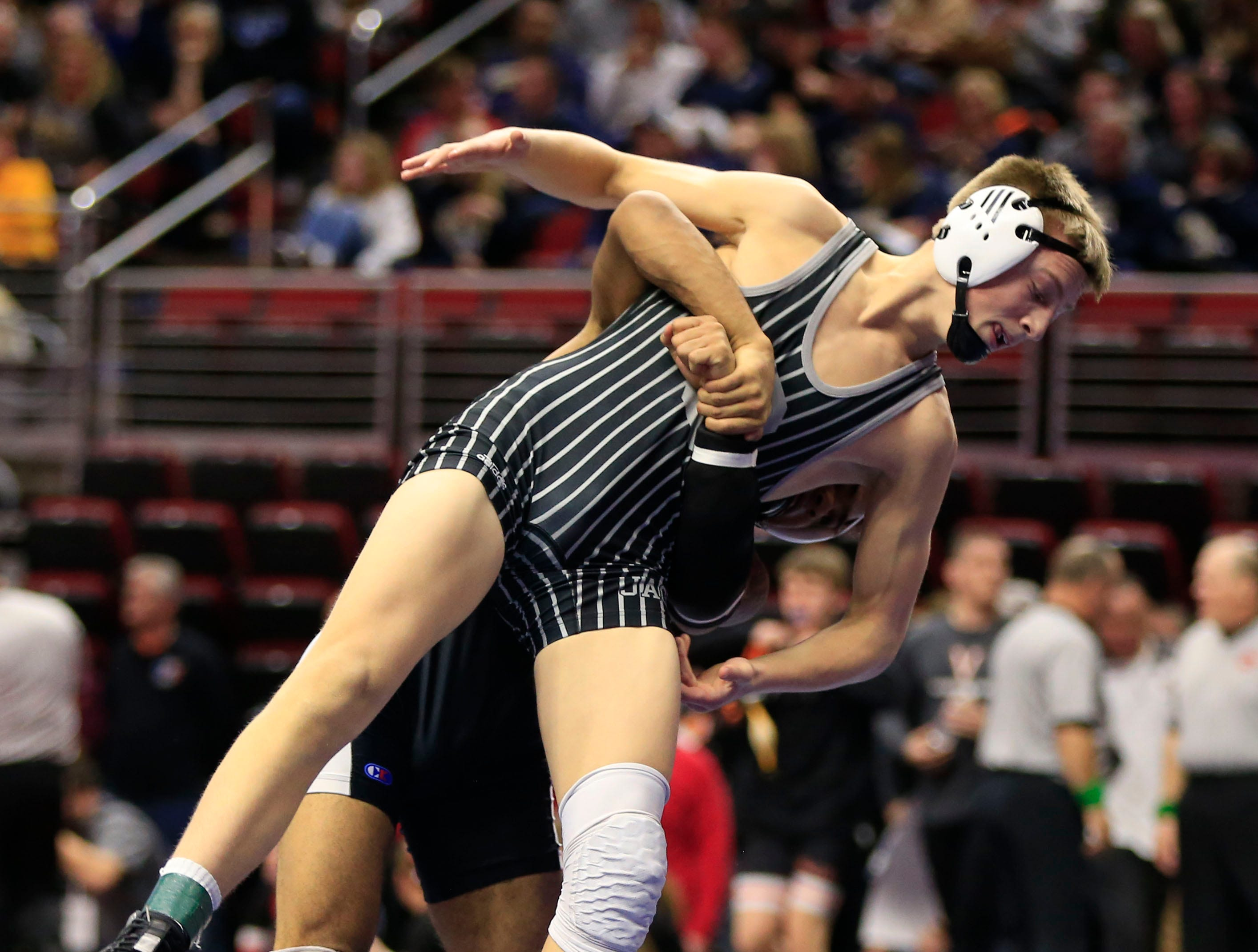 Eric Owens of Ankeny Centennial defeats Deville Dentis of Des Moines East during a 145 Lb 3A semifinal match at the state wrestling tournament Friday, Feb. 15, 2019.
