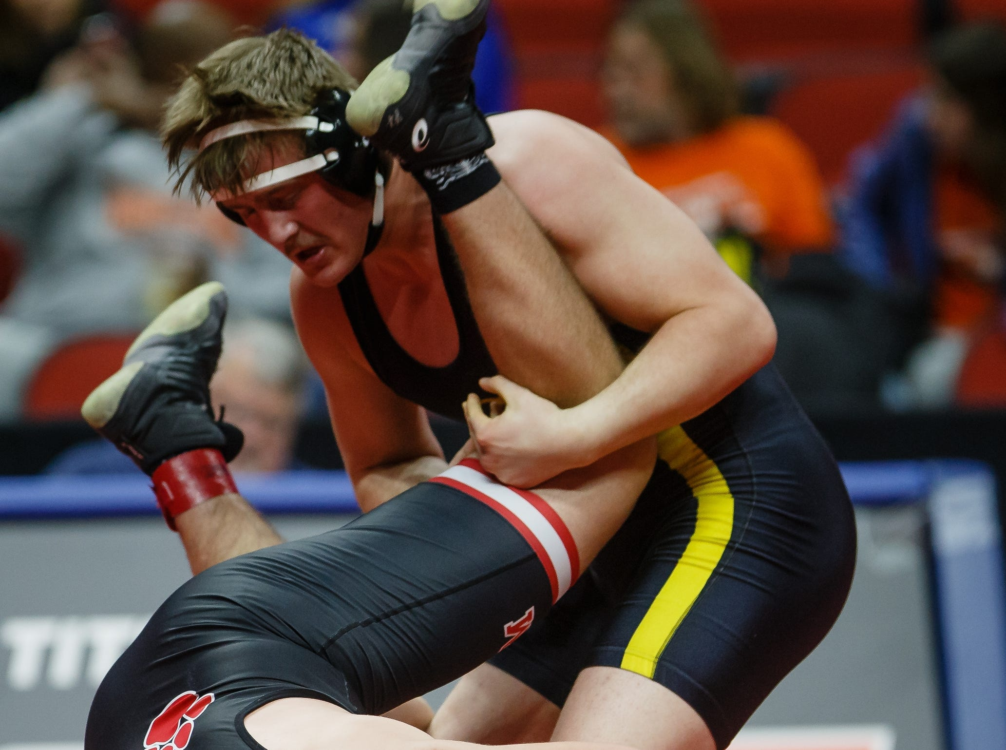 Kade Hambly of Clear Lake wrestles Kaden Sutton of ADEM during their class 2A 220 pound state championship semi-final match on Friday, Feb. 15, 2019 in Des Moines. Sutton advances to the finals.