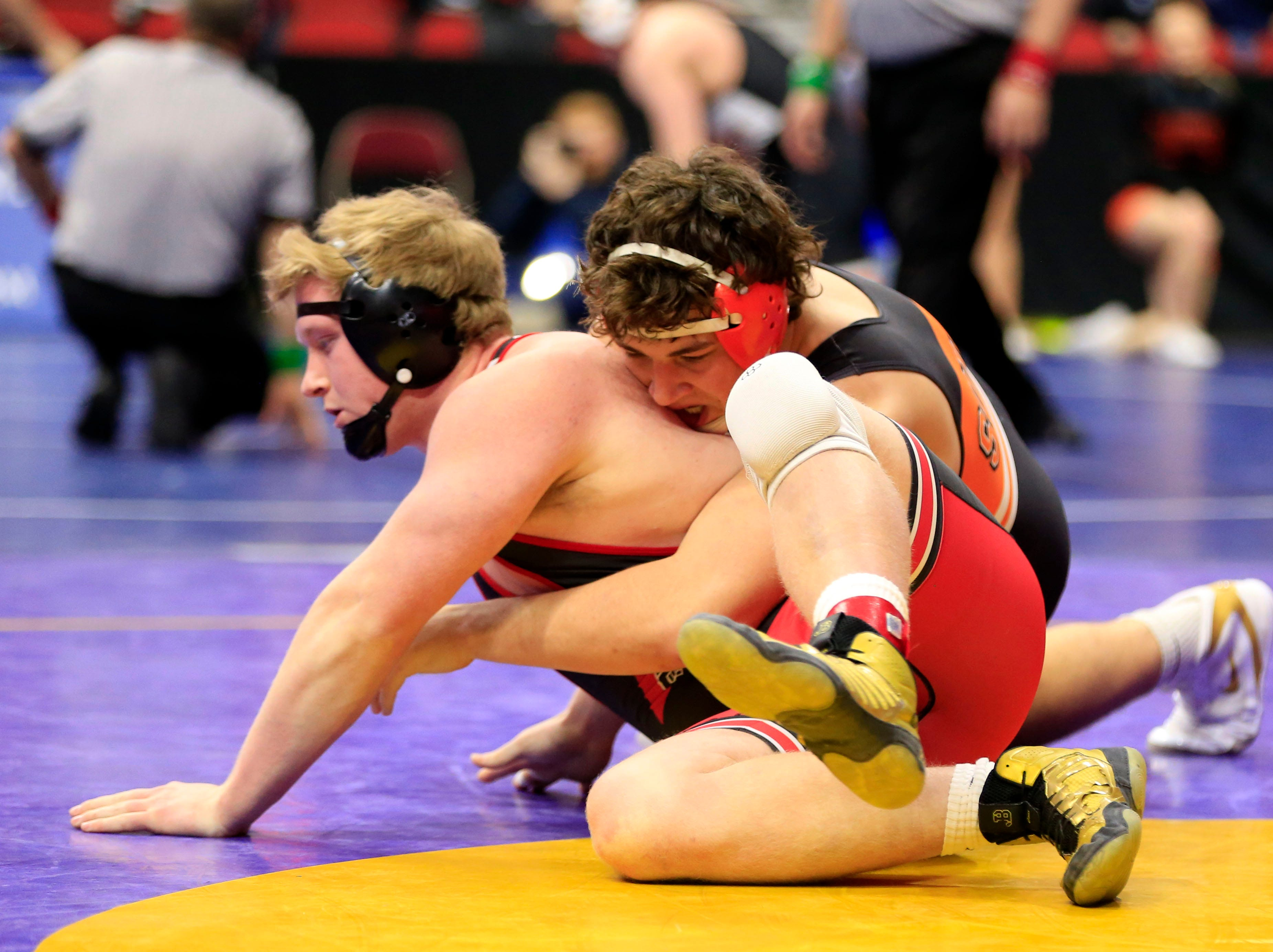 Mike Hoyle of Solon defeats Seth Adrian of Assumption during a 220 Lb 2A quarterfinal match at the state wrestling tournament Friday, Feb. 15, 2019.