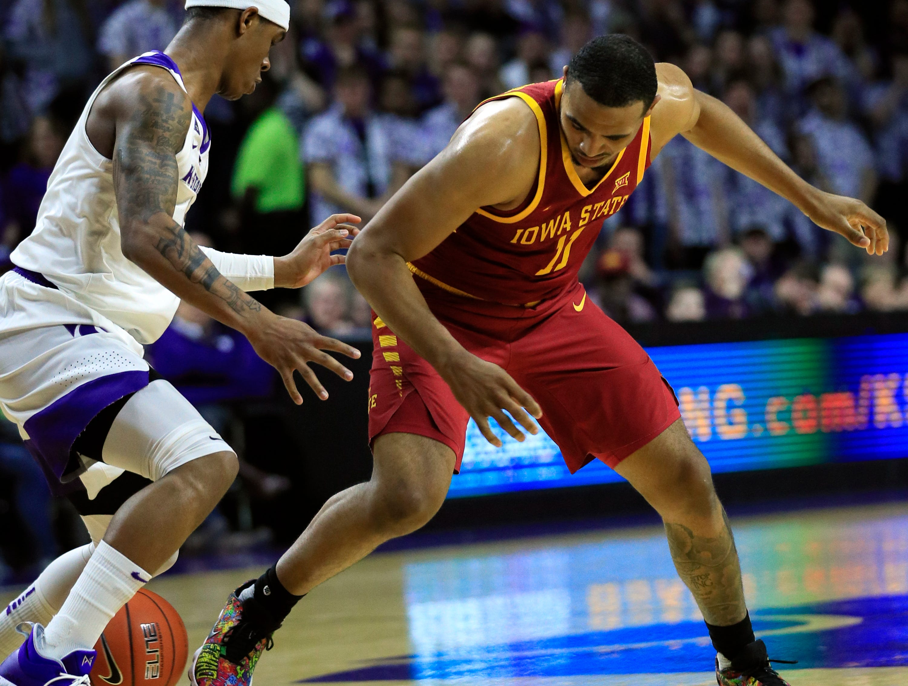 Kansas State guard Shaun Neal-Williams, left, forces a turnover from Iowa State guard Talen Horton-Tucker (11) during the first half of an NCAA college basketball game in Manhattan, Kan., Saturday, Feb. 16, 2019.