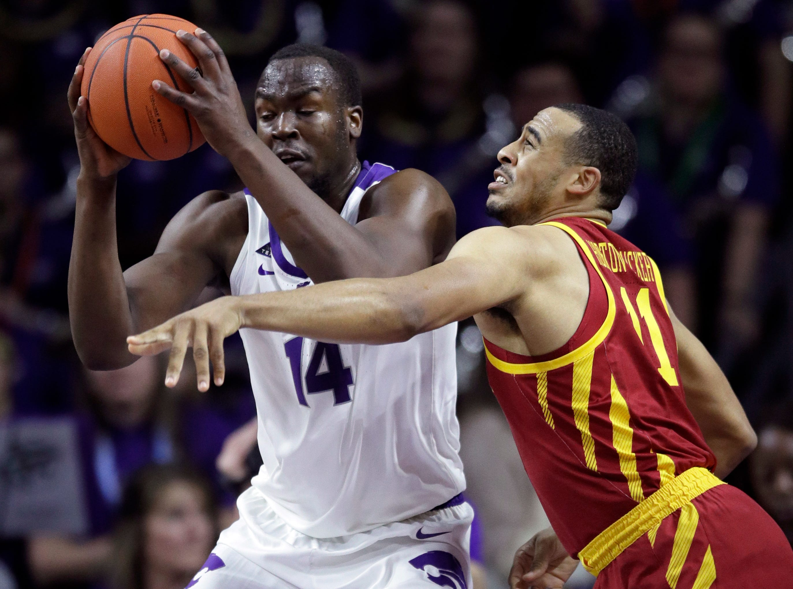 Iowa State guard Talen Horton-Tucker (11) covers Kansas State forward Makol Mawien (14) during the first half of an NCAA college basketball game in Manhattan, Kan., Saturday, Feb. 16, 2019.
