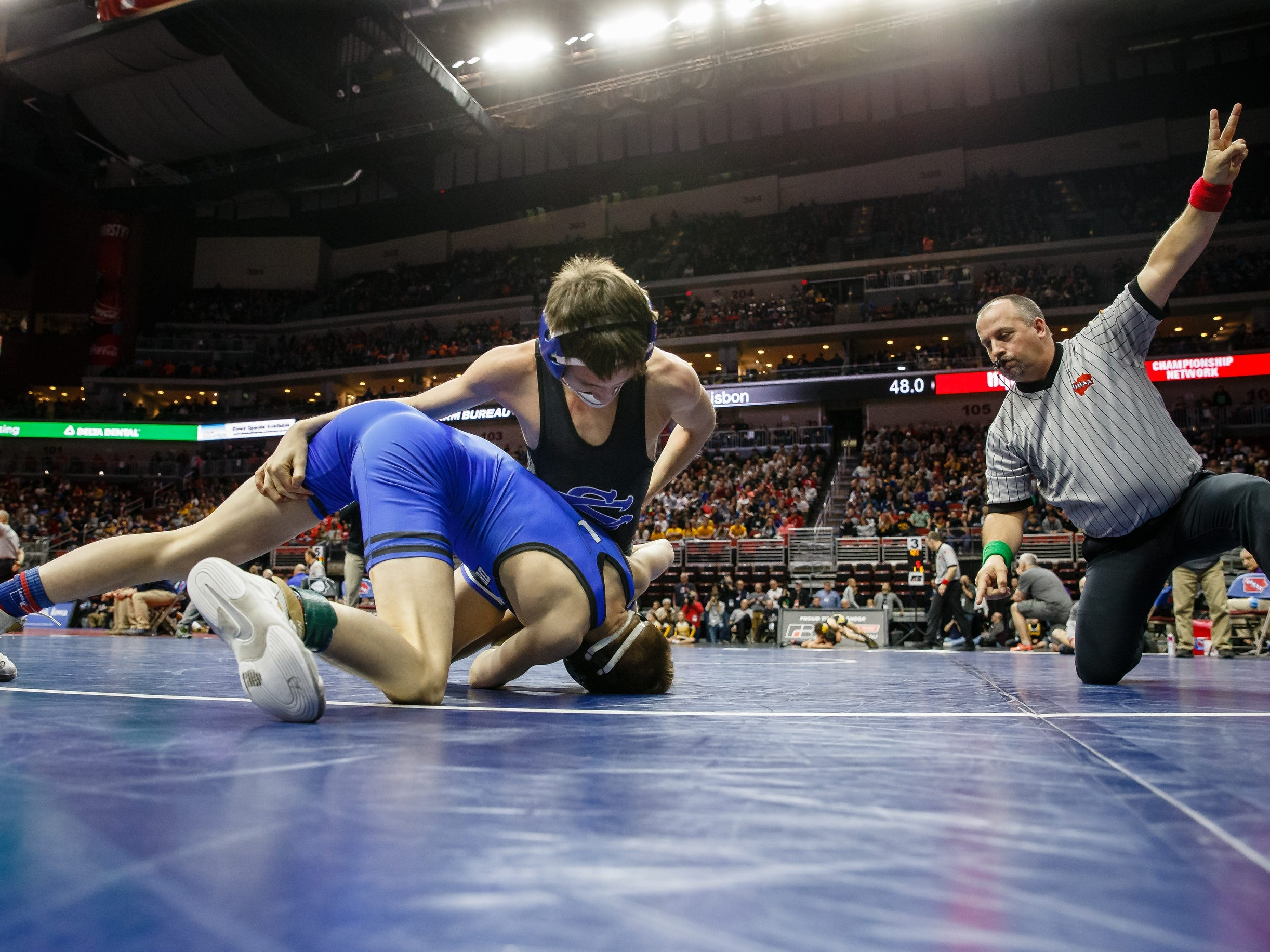 Stevie Barnes of Underwood wrestles Clayton McDonough of Central Springs during their class 1A 106 pound state championship semi-final match on Friday, Feb. 15, 2019 in Des Moines. Barnes advances to the finals with a 4-2 sudden victory.