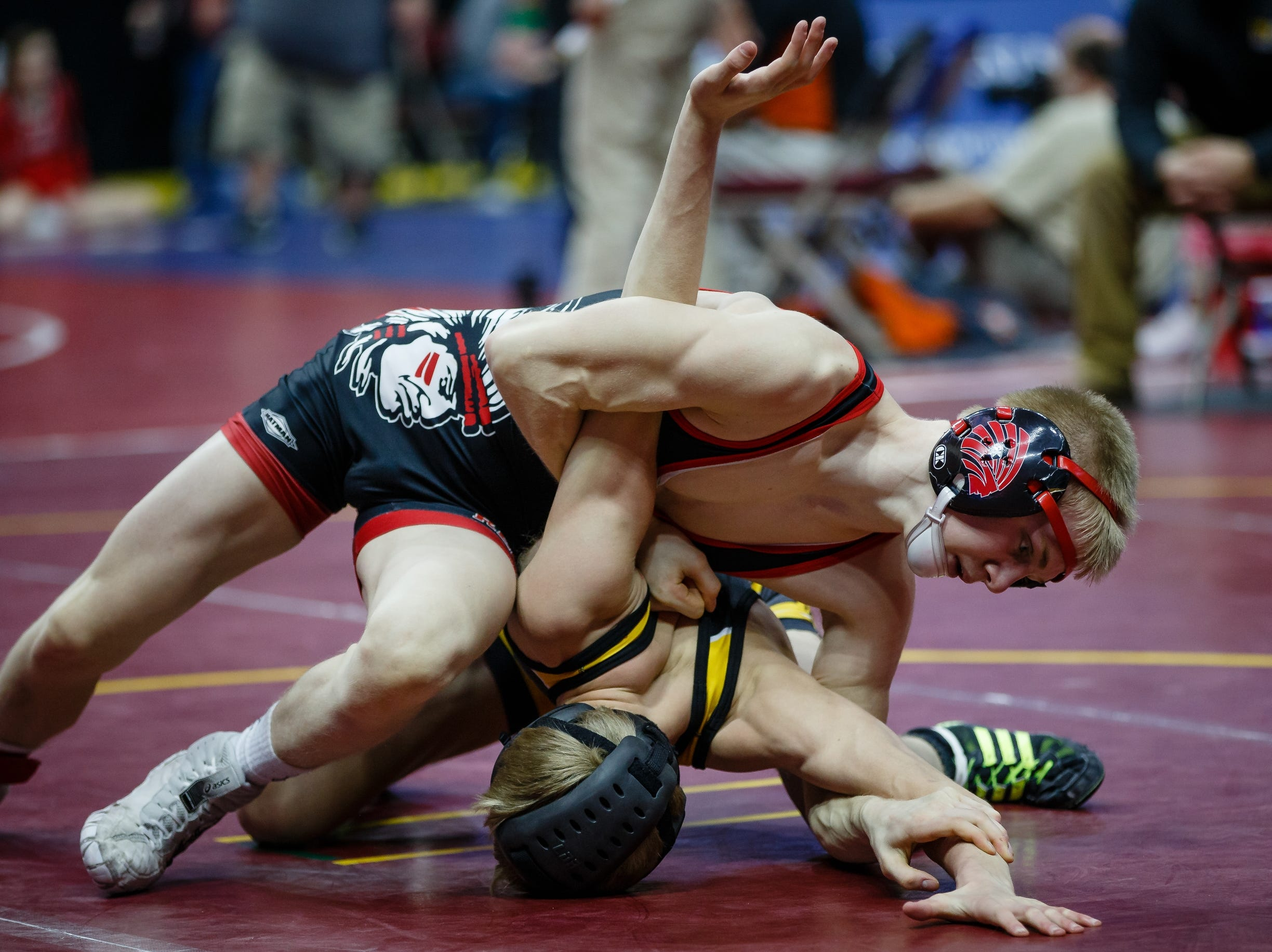 Matthew Lewis of Centerville wrestles Cole Whitehead of Center Point-Urbana during their class 2A, 113-pound state championship semifinal match on Friday. Lewis advances to the finals.