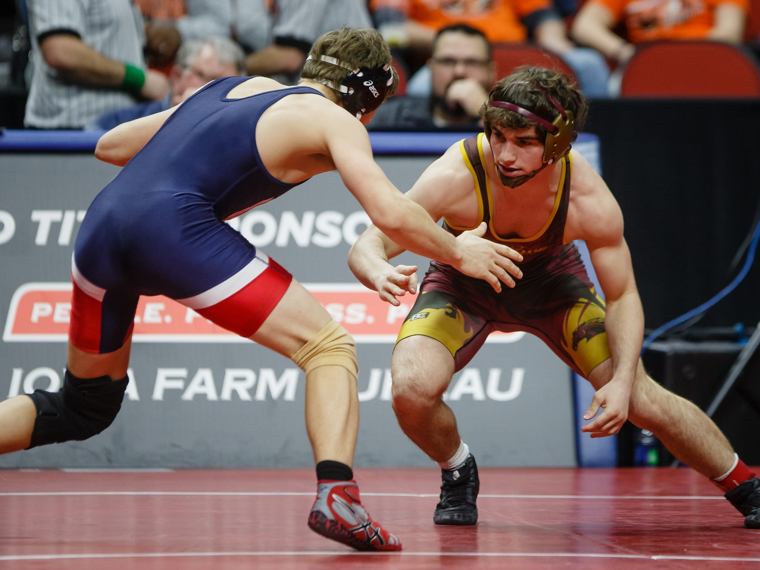 Wes Cummings of PCM wrestles Skyler Noftsger of Ballard during their class 2A, 160-pound state championship semifinal match on Friday in Des Moines. Skyler Noftsger moves on with a 10-7 decision.