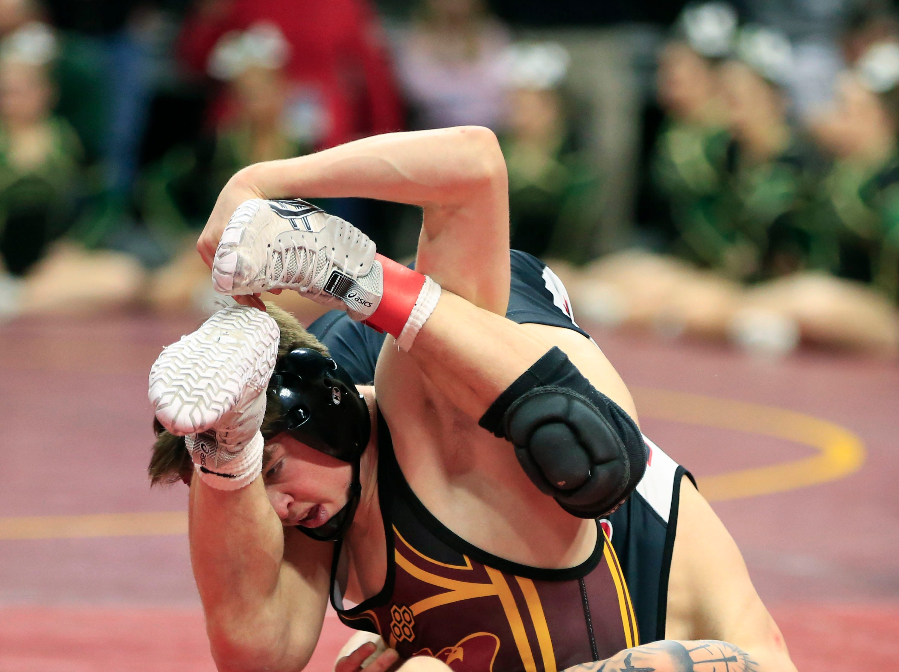 Caleb Rathjen of Ankeny defeats Matthew Jordan of Des Moines East during a 126 Lb 3A semifinal match at the state wrestling tournament Friday, Feb. 15, 2019.