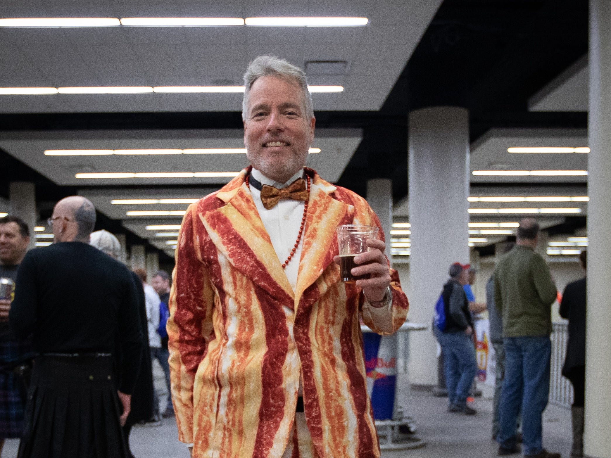 Russell Gilson, of Des Moines, shows off his bacon suit during the Bacon Fest at Hy-Vee Hall on Feb. 16, 2019 in Des Moines, Iowa.