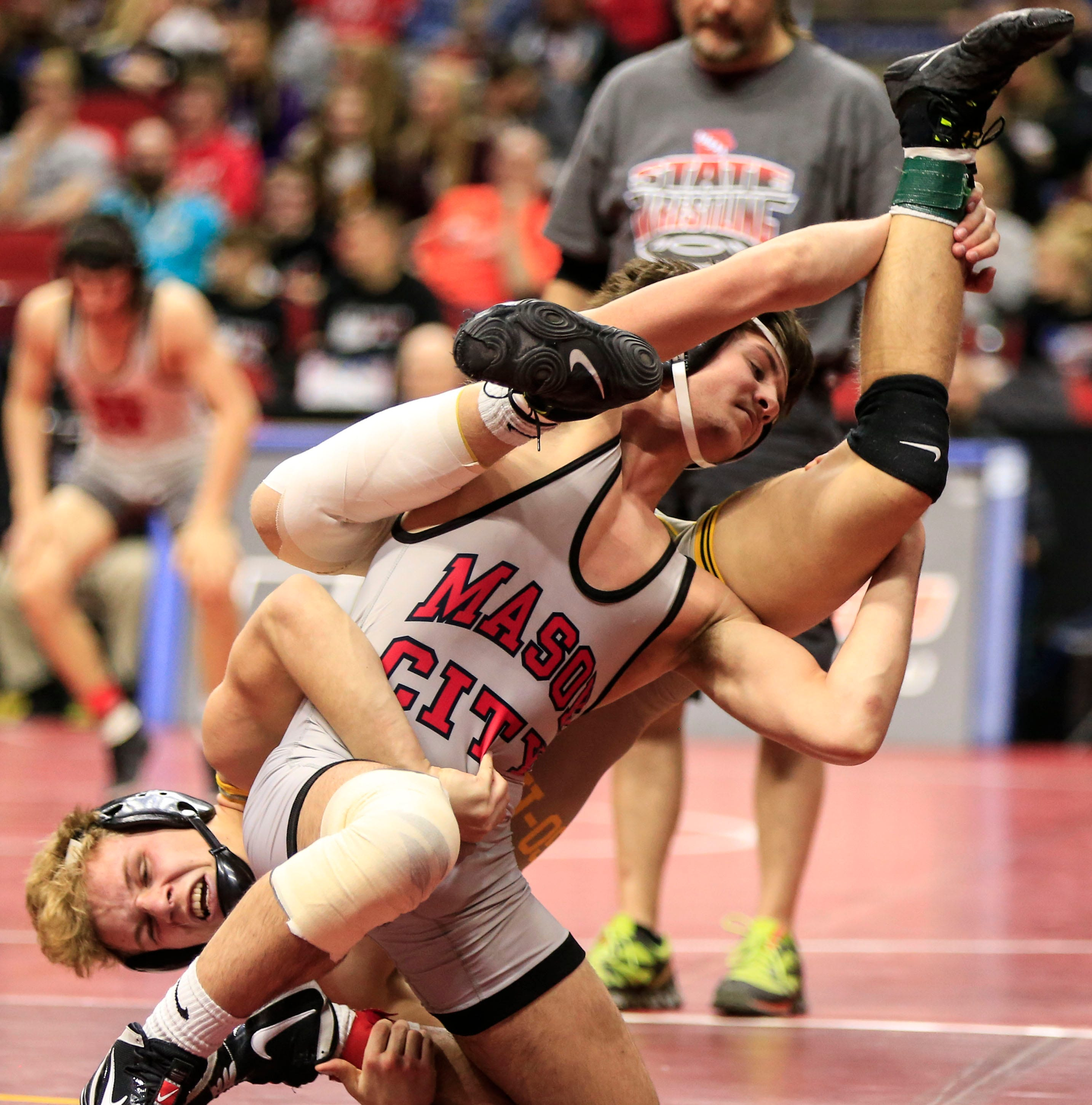 State wrestling: Motivated by brother's semifinal loss, Mason City's Colby Schriever reaches 3A finals