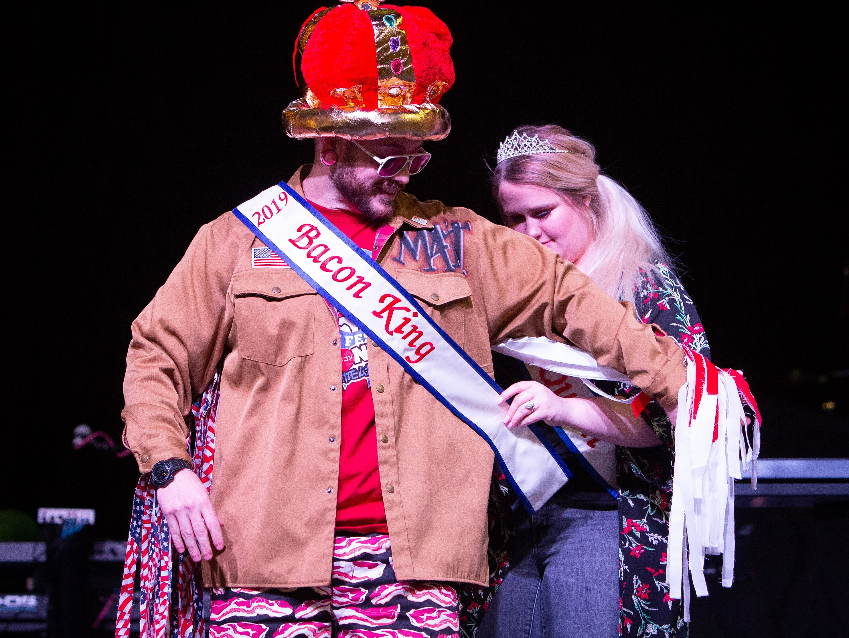 Matt Weis, of Ankeny, gets crowned as the Bacon King during the Bacon Fest at Hy-Vee Hall on Feb. 16, 2019 in Des Moines, Iowa.