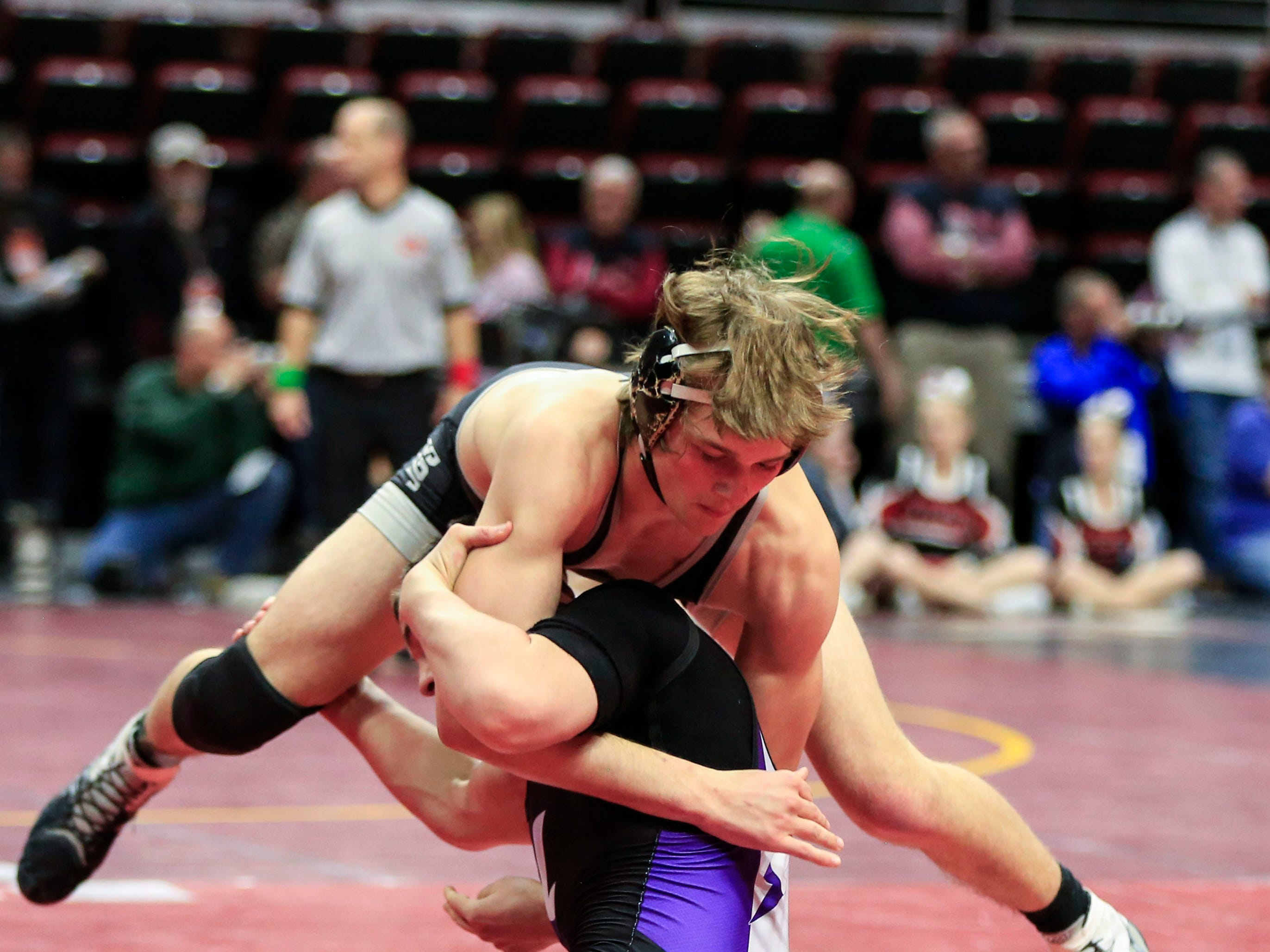 Logan Neils of Ankeny Centennial defeats Ashton Barker of Iowa City, Liberty during a 170 Lb 3A semifinal match at the state wrestling tournament Friday, Feb. 15, 2019.