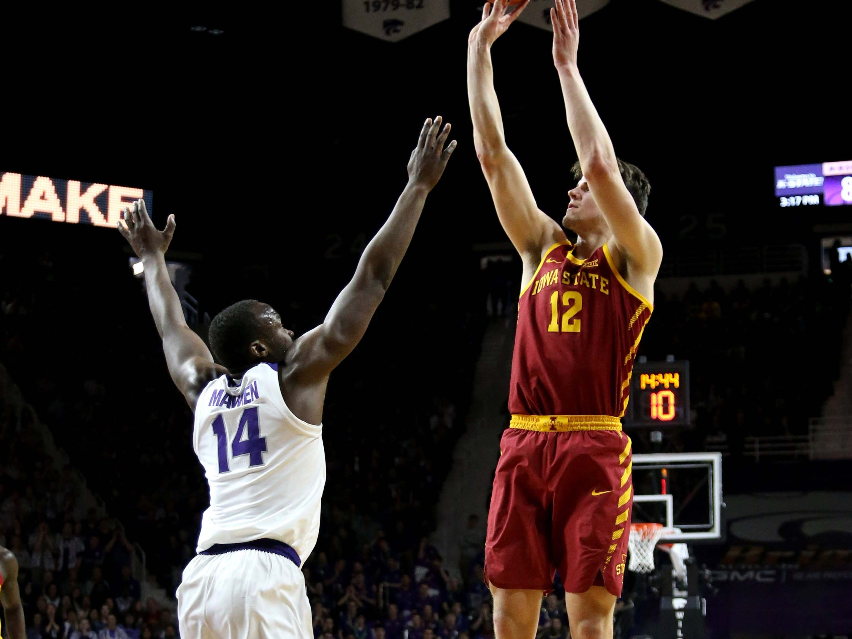 Feb 16, 2019; Manhattan, KS, USA; Iowa State Cyclones forward Michael Jacobson (12) shoots over Kansas State Wildcats forward Makol Mawien (14) during the first half at Bramlage Coliseum.