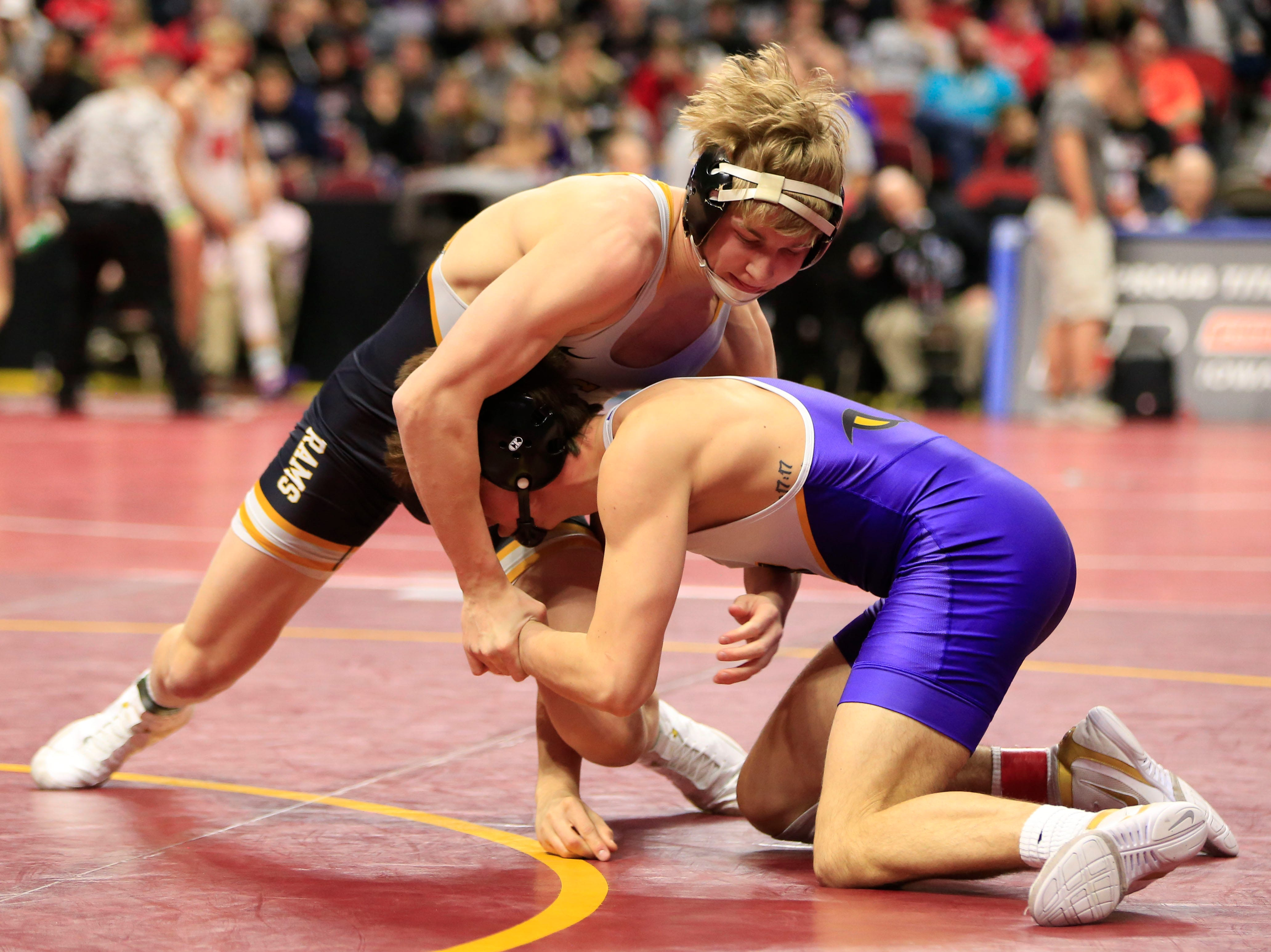 Lance Runyon of Southeast Polk defeats Cade Moss of Johnston during a 152 Lb 3A semifinal match at the state wrestling tournament Friday, Feb. 15, 2019.