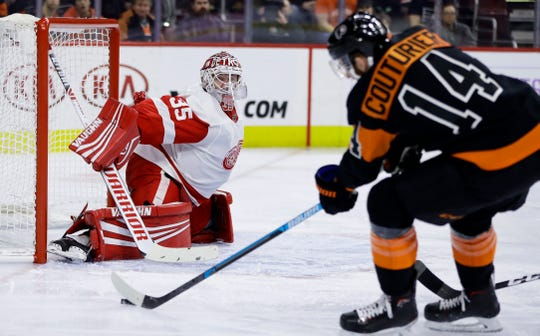 Jimmy Howard blocks a shot by the Flyers' Sean Couturier during the second period Saturday in Philadelphia.