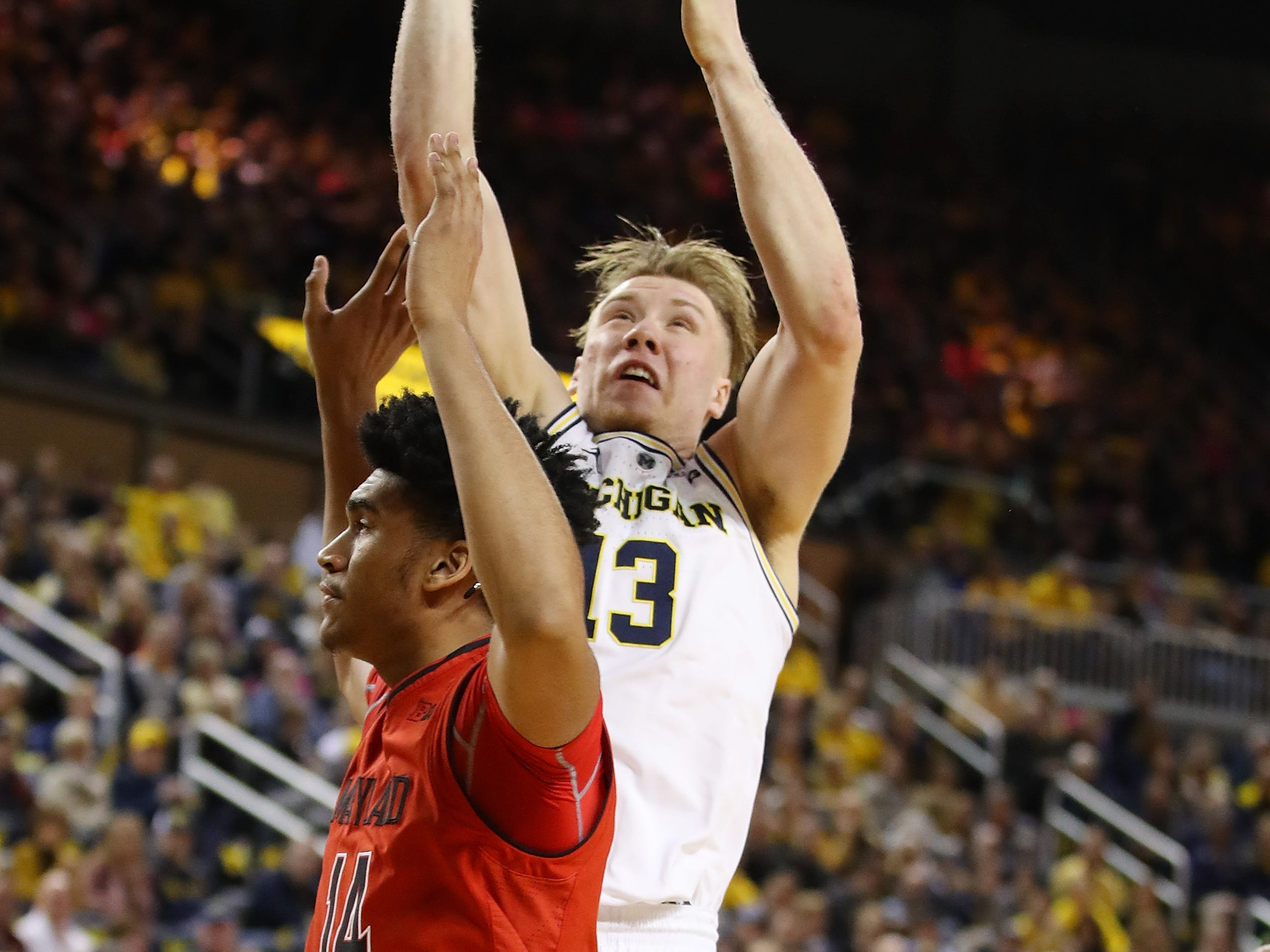 Michigan's Ignas Brazdeikis takes a first-half shot over Maryland's Ricky Lindo Jr. at Crisler Center on Feb. 16, 2019 in Ann Arbor.