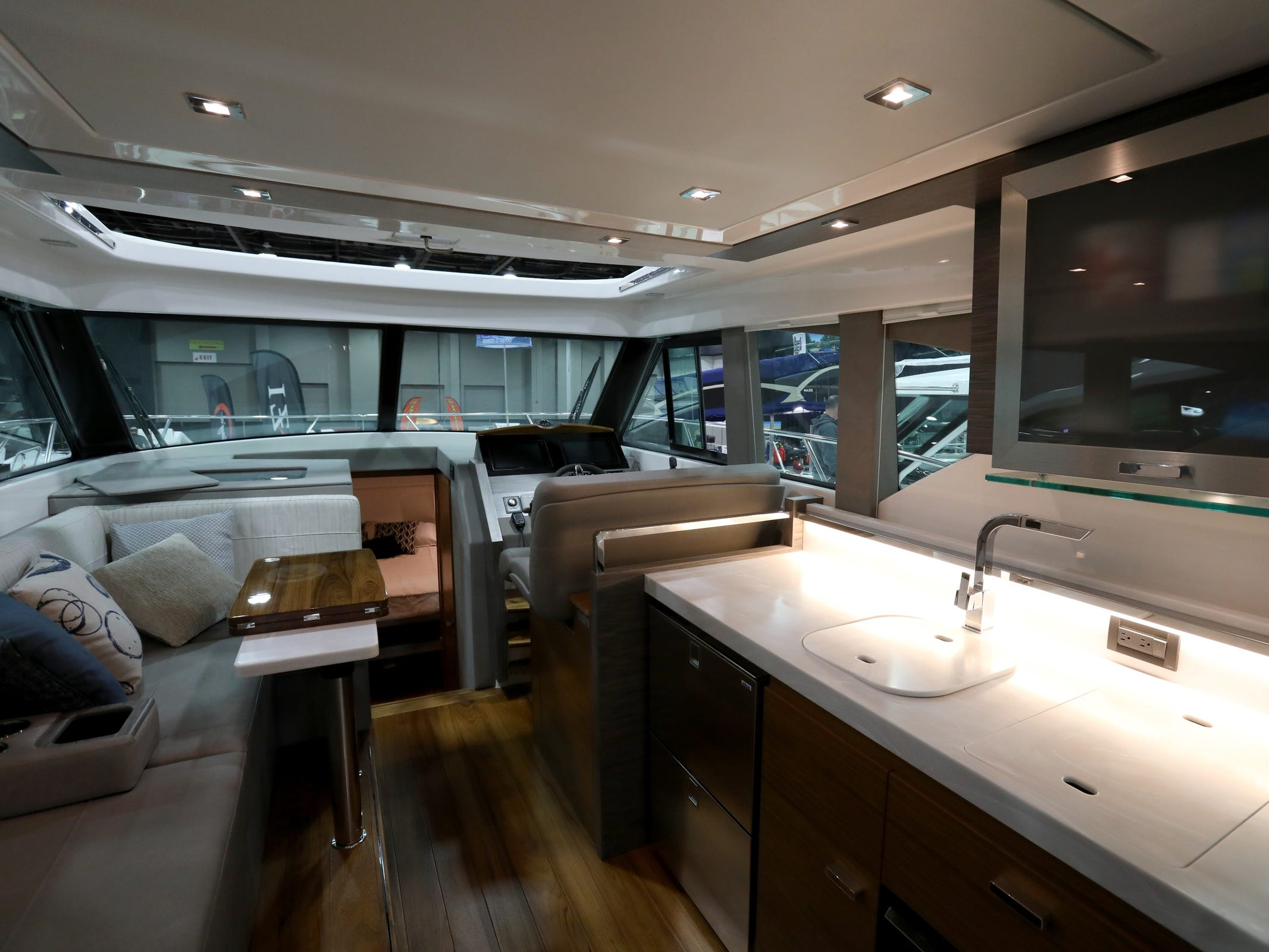 A look at the inside sitting space, kitchen area of the $695,000 Tiara 39 foot Coupe at the Skipper Buds display during the week long Detroit Boat Show at Cobo Center in Detroit on Saturday, February 16, 2019.