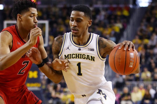Michigan's Charles Matthews drives around Maryland's Aaron Wiggins during the first half at Crisler Center on Feb. 16, 2019 in Ann Arbor.