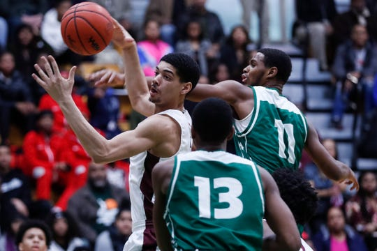 Detroit Renaissance's Chandler Turner battles for a rebound vs. Detroit Cass Tech.