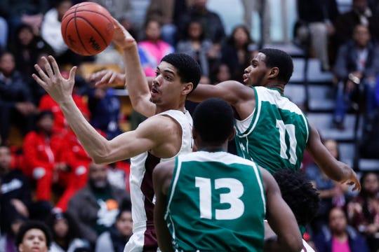 Detroit Renaissance's Chandler Turner battles for a rebound vs. Detroit Cass Tech.