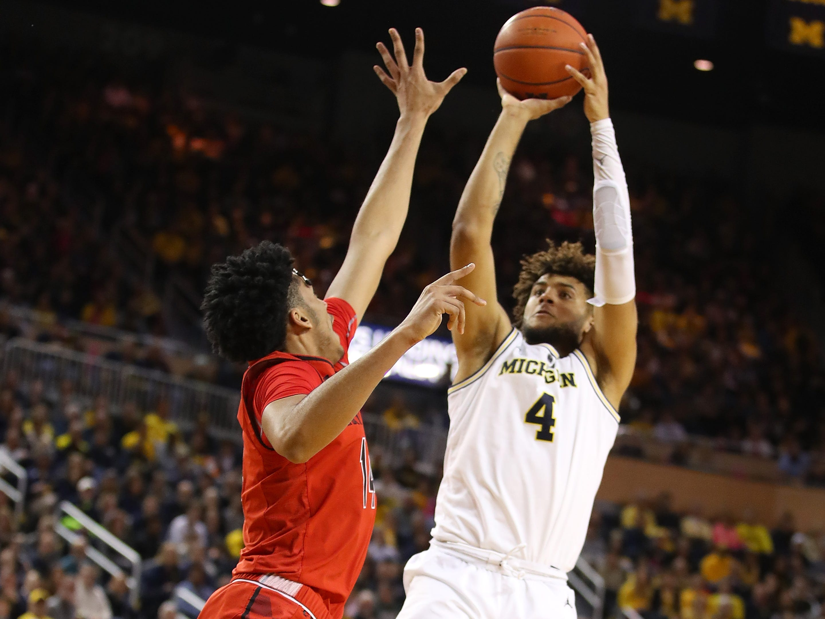 Michigan's Isaiah Livers shoots over Maryland's Ricky Lindo Jr. at Crisler Center on Feb. 16, 2019 in Ann Arbor.