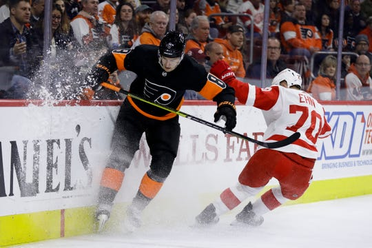 Flyers' Robert Hagg and Red Wings' Christoffer Ehn chase a loose puck during the first period Saturday in Philadelphia.