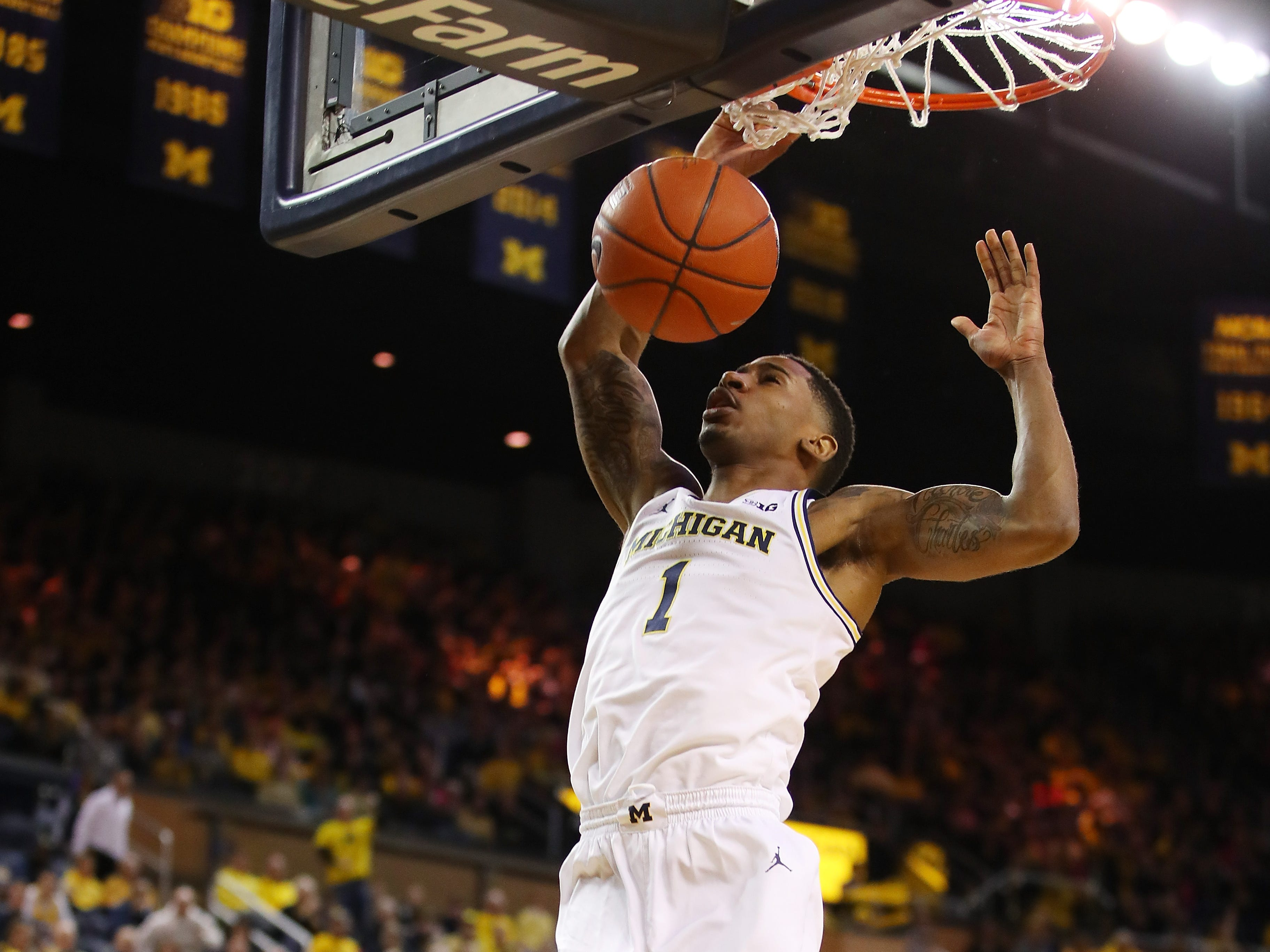 Michigan's Charles Matthews dunks against Maryland in the first half at Crisler Center on Feb. 16, 2019 in Ann Arbor.