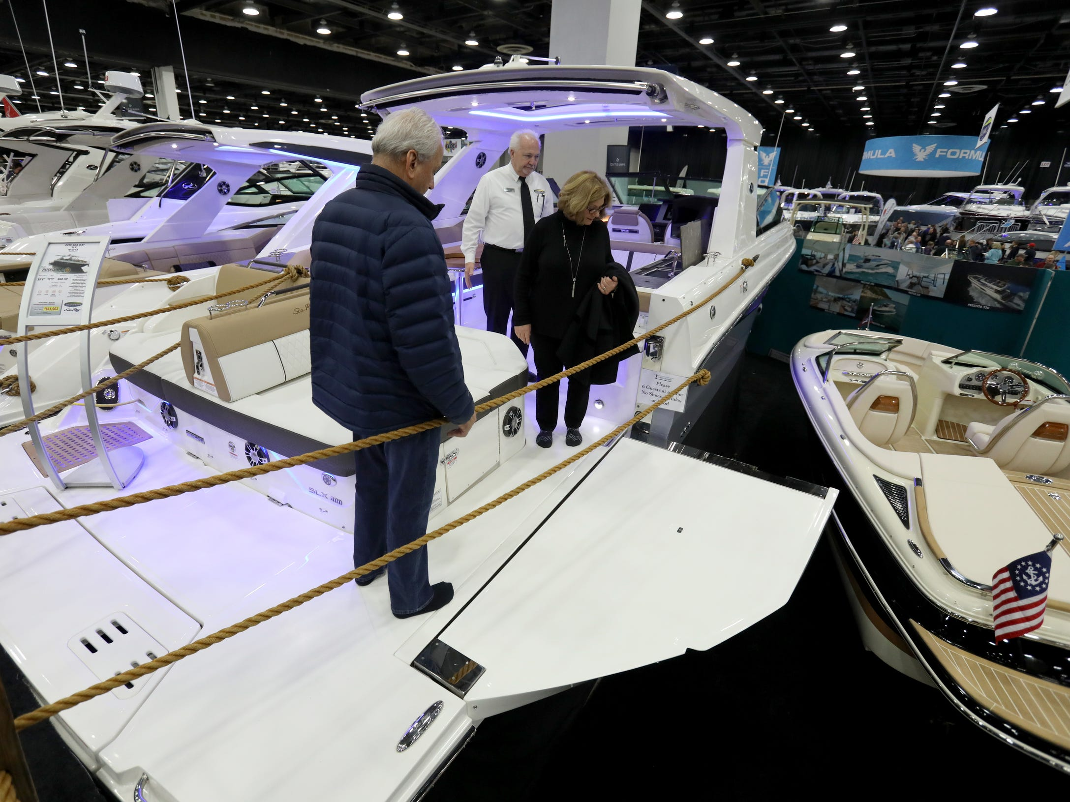 """One of unique features of the 2019 Sea Ray SLX 400 """"The Entertainer"""" that costs $561,502 is this hydraulic terrace on the boat that folds down serving as a swimming platform,It was one of hundreds of boats on display during the Detroit Boat Show at Cobo Center in Detroit on Saturday, February 16, 2019.."""