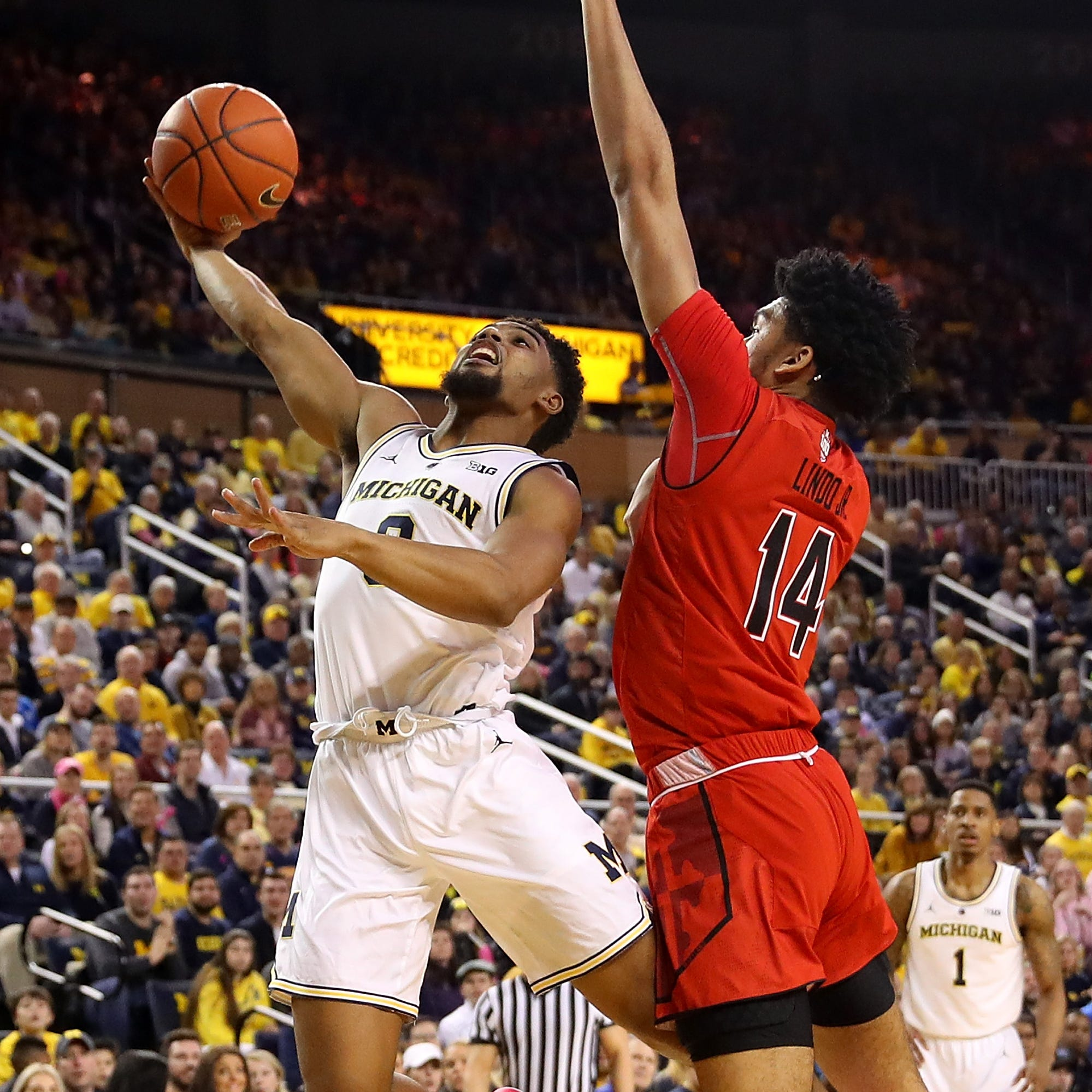 Michigan basketball freshman David DeJulius gets rare early playing time