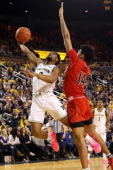 Michigan's David DeJulius drives to the basket past Maryland's Ricky Lindo Jr. during the first half at Crisler Center on Feb. 16, 2019 in Ann Arbor.