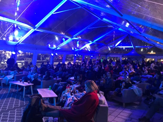 A heated tent becomes a movie theater at Beacon Park's February Flicks series.