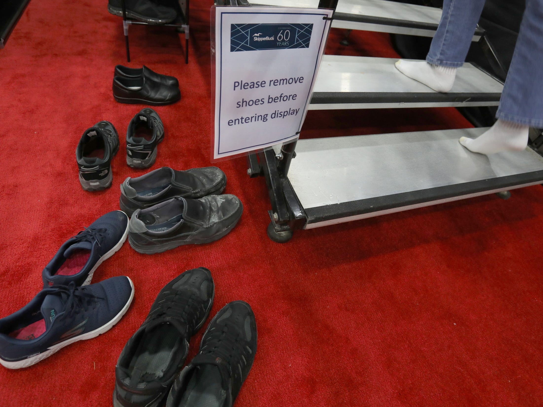 Because of the expensive yachts for sale at the Skipper Buds display people had to take off their shoes so the flooring of yachts and boats wouldn't get scuffed or marked up during the Detroit Boat Show at Cobo Center in Detroit on Saturday, February 16, 2019.