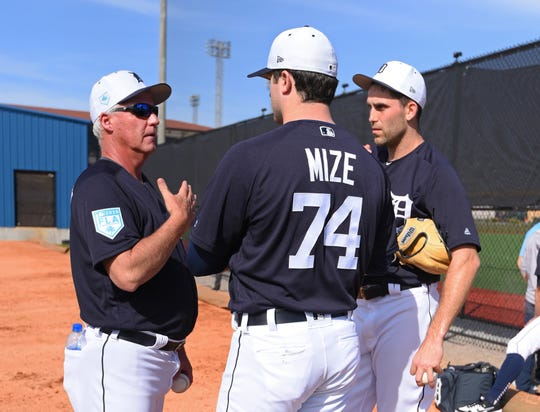 Detroit Tigers pitching coach Rick Anderson, left, talks with pitchers Casey Mize, center, and Matthew Boyd during spring training workouts at the Tiger Town Complex on Feb. 15, 2019, in Lakeland, Fla.