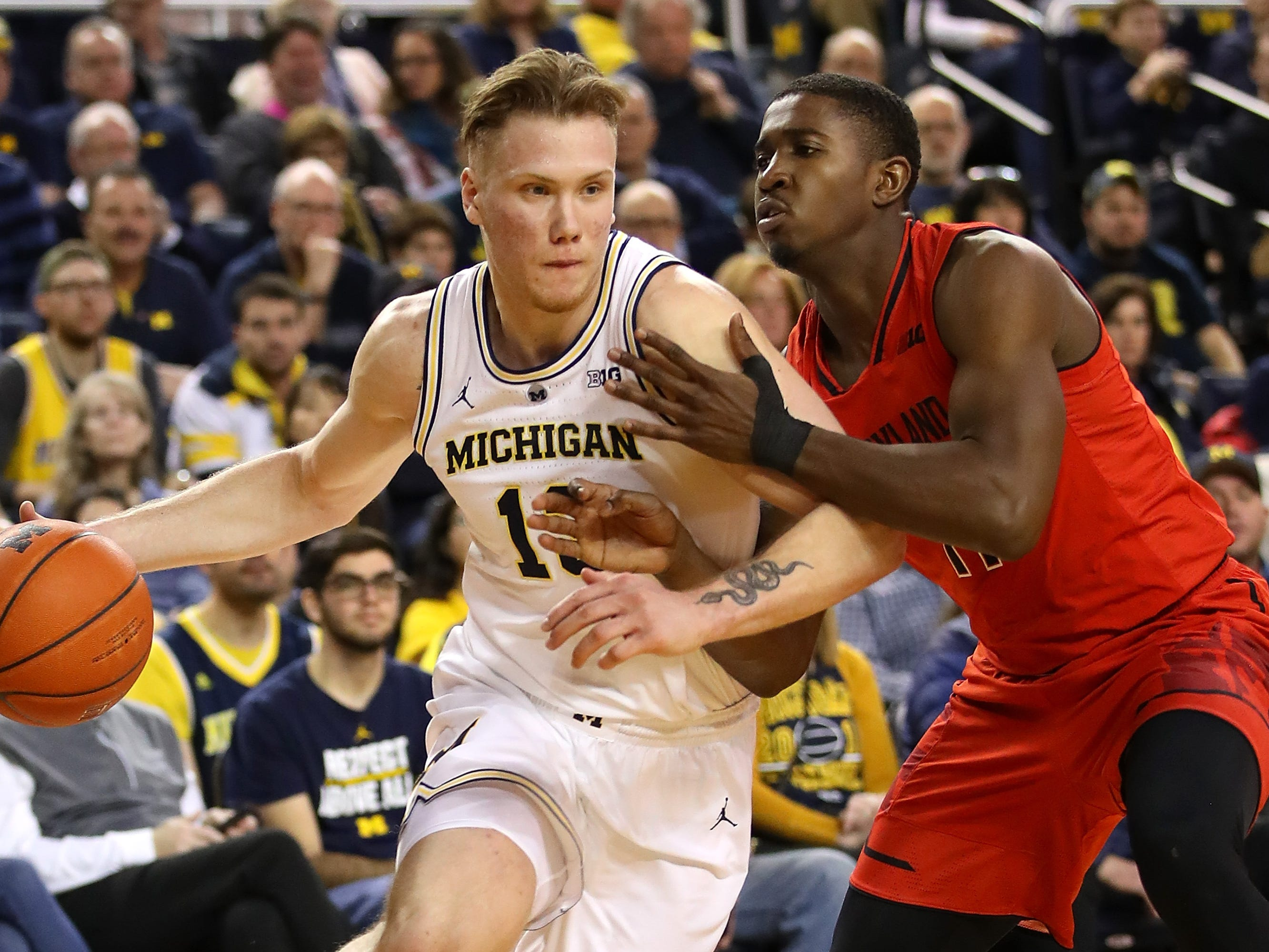 Michigan's Ignas Brazdeikis drives around Maryland's Darryl Morsell during the first period at Crisler Arena on Feb. 16, 2019 in Ann Arbor.